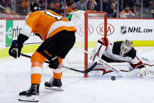 Philadelphia Flyers' Nolan Patrick, left, takes a shot against New Jersey Devils' Keith Kinkaid during the second period of an NHL hockey game, Thursday, Nov. 15, 2018, in Philadelphia.