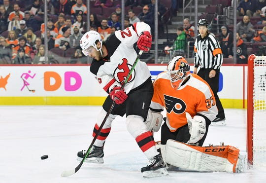 Nov 15, 2018; Philadelphia, PA, USA; New Jersey Devils right wing Stefan Noesen (23) screens Philadelphia Flyers goaltender Brian Elliott (37) during the second period at Wells Fargo Center.
