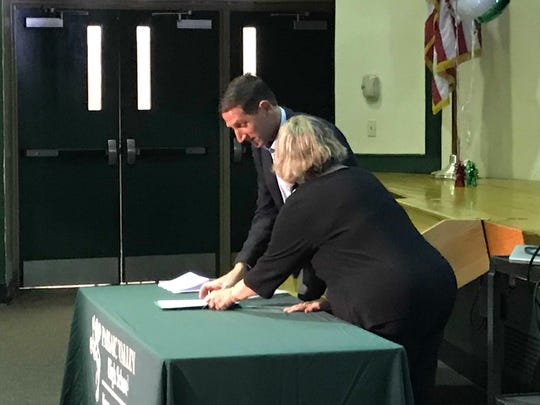 PV Superintendent  JoAnn Cardillo signs agreement with MSU Director of Communication and Media Keith Strudler on Friday.