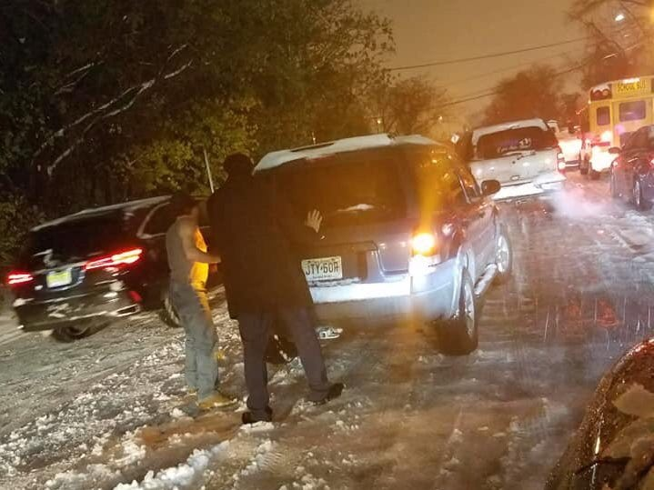 Paterson Mayor Andre Sayegh, right, helping a driver stuck in the snow on Thursday night, Nov. 15, 2018.