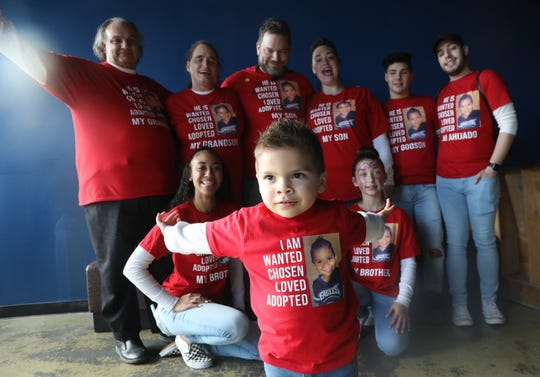 The Palmarini family, of Williamstown, adopted Noah, 2, front and center, on National Adoption Day.