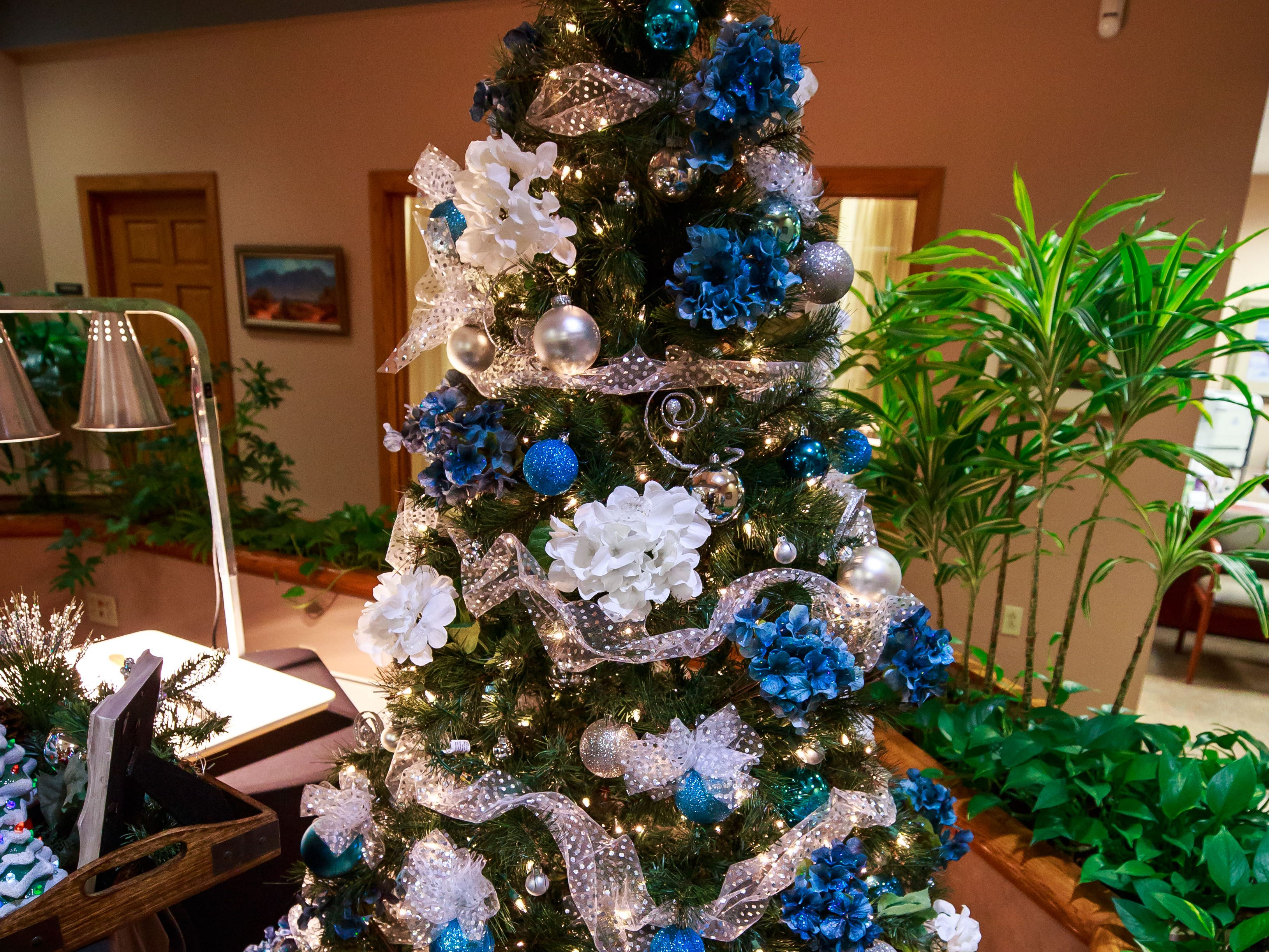 """I'm Dreaming of a Blue Christmas,"" donated and decorated by Jan's Special Treasures,  was one of the items for sale in a benefit for Cowboys for Cancer Research, held Thursday, Nov. 15, 2018, at First American Bank."
