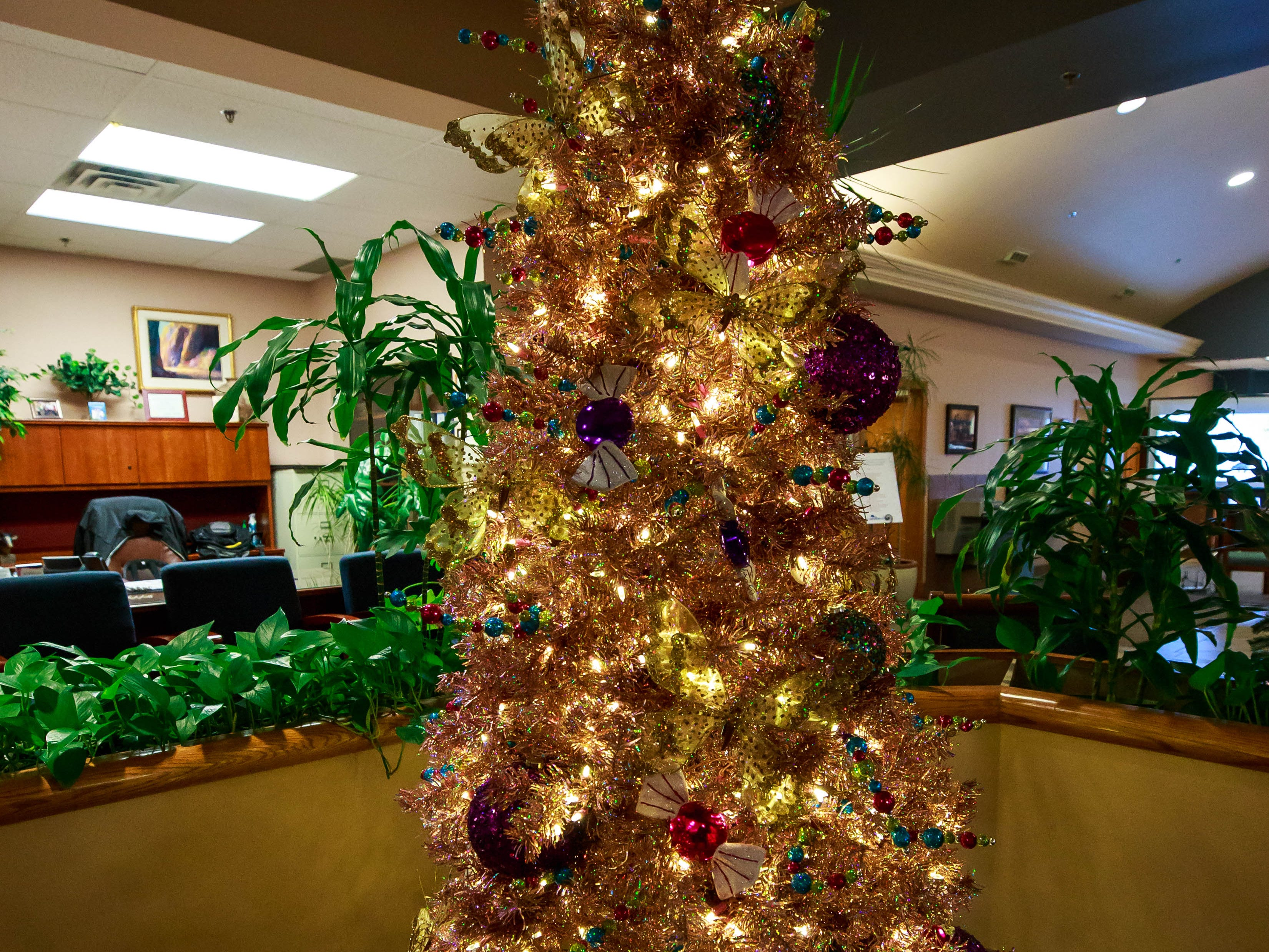 """Mariposas de Oro,"" donated and decorated by Ashley HomeStore,  was one of the items for sale in a benefit for Cowboys for Cancer Research, held Thursday, Nov. 15, 2018, at First American Bank."