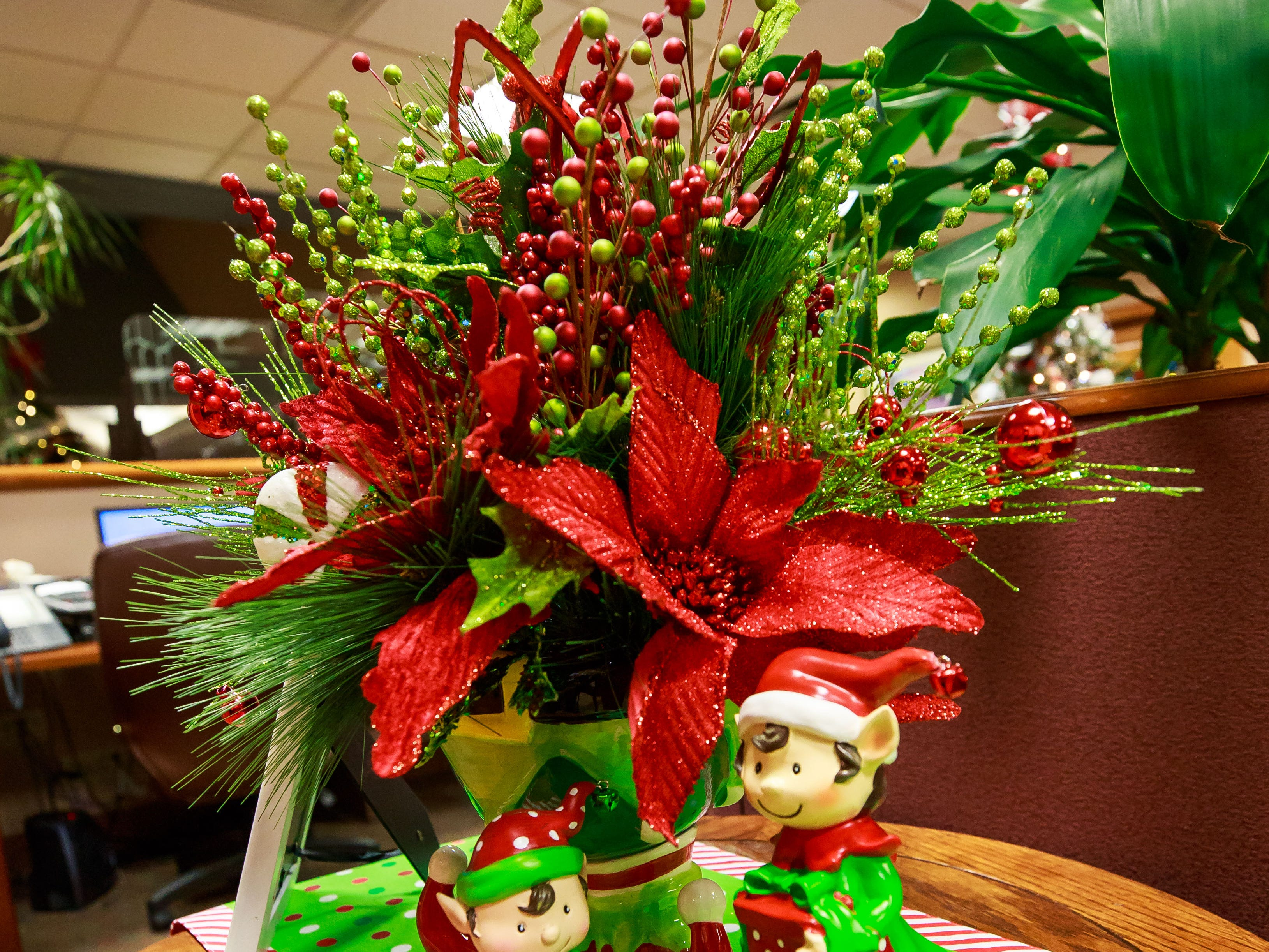 """The Snowman's Ball"" table decor, donated by RT Electric,  was one of the items for sale in a benefit for Cowboys for Cancer Research, held Thursday, Nov. 15, 2018, at First American Bank."