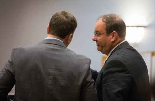 Nelson Goodin, right, the Doña Ana County attorney, talks with Carter B. Harrison, left, attorney for Yvette Herrell, candidate for Congressional District Two, during a hearing where Herrell's team is asking for the absentee ballots from the midterm elections to be impounded. Friday November 16, 2018 at the Third Judicial District Court.