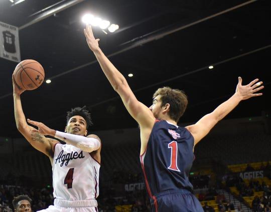 JoJo Zamora shoots a hook against Saint Mary's on Wednesday night at the Pan American Center.