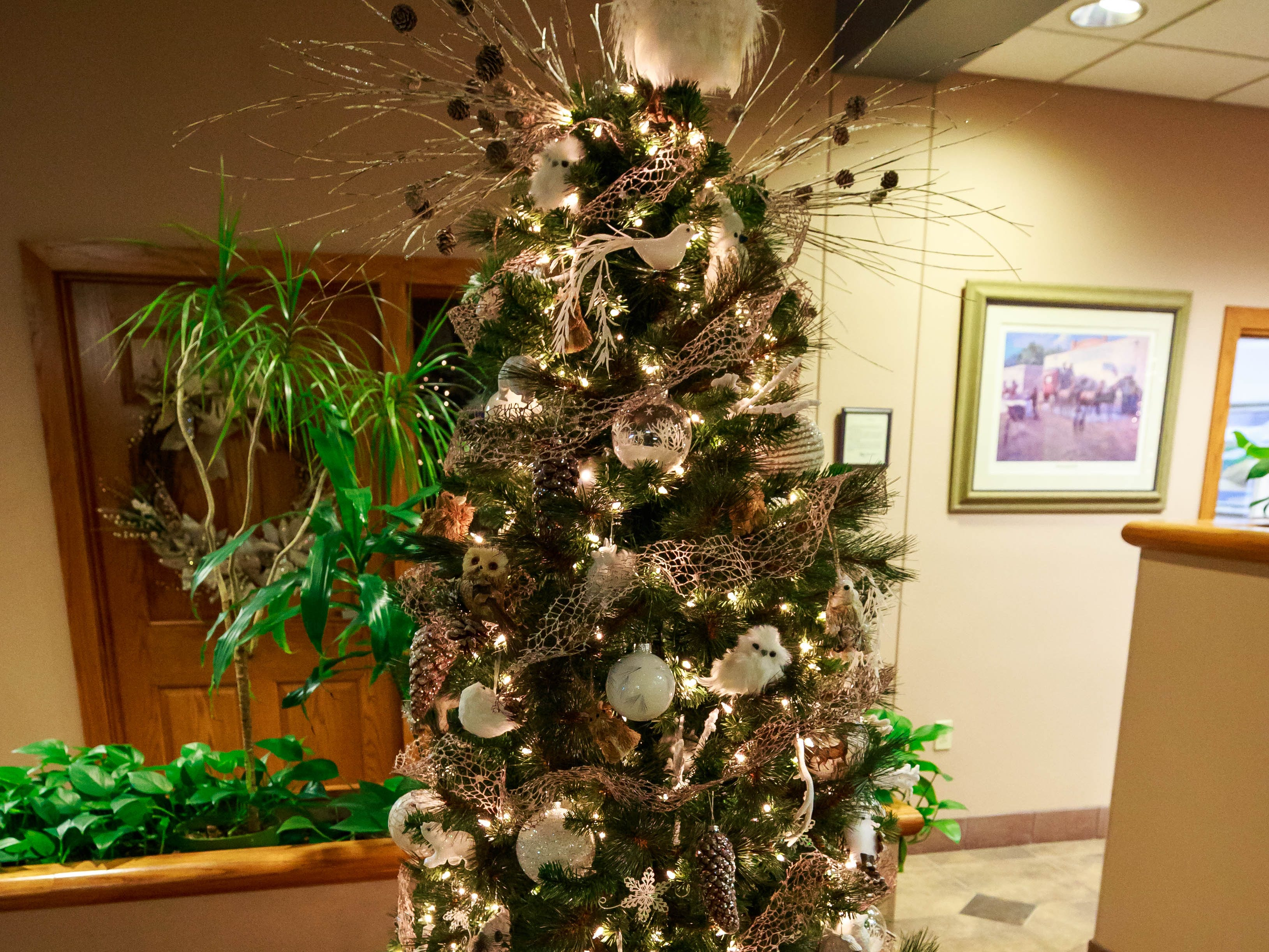 """Enchanted Forest,"" donated by Southwest Abstract & Title Company,  was one of the items for sale in a benefit for Cowboys for Cancer Research, held Thursday, Nov. 15, 2018, at First American Bank."