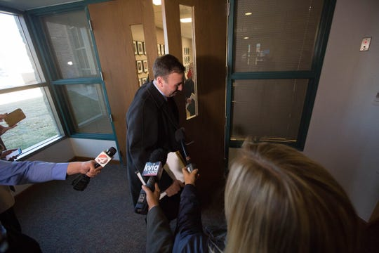 Carter B. Harrison, attorney for Yvette Herrell, passes through a scrum of reporters, saying he can't give comment after a closed-door meeting with Doña Ana County attorneys and the Clerks Office, Friday November 16, 2018 after an initial hearing about the possibility of impounding absentee ballots from the midterm election, at the Third Judicial District Court.