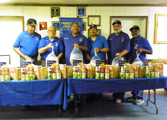 Members of Prince Hall Lodge #11 hoist turkeys that they would soon deliver to area families. From left to right, Past Master Charles Norman, Honorary Past Grandmaster Charles Cromer, Worshipful Master Everette Brown, Senior Warden Frank Woods, Past Master Kenneth Woods, and Past Master Herb Jones.