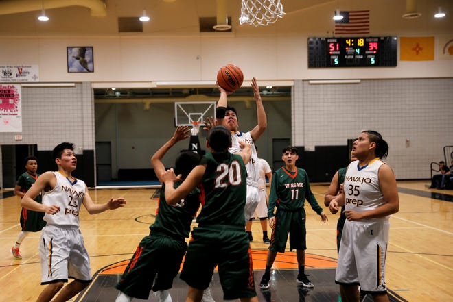 Navajo Prep's Thomas Montanez puts up a contested shot against Wingate during a district basketball game on Feb. 6 at the Eagles Nest in Farmington. Montanez will be among several key returners for Prep this season.