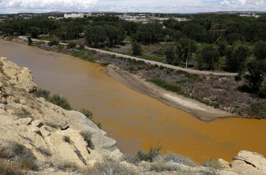 Water from the Animas River mixes with the San Juan River on Aug. 8, 2015, shortly after the Gold King Mine spill. Members of the Navajo Nation listened to reports about ongoing activities to address the spill on Thursday.