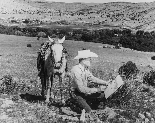 Peter Hurd painting in his valley east of Ruidoso.