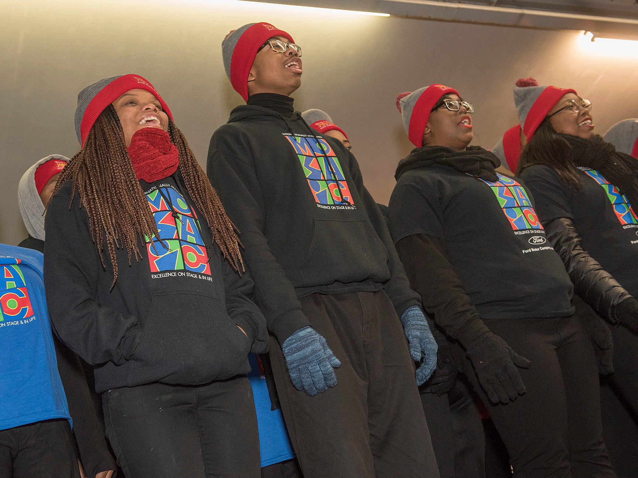 The Mosaic Youth Theater of Detroit choir spreading holiday cheer with their voices.