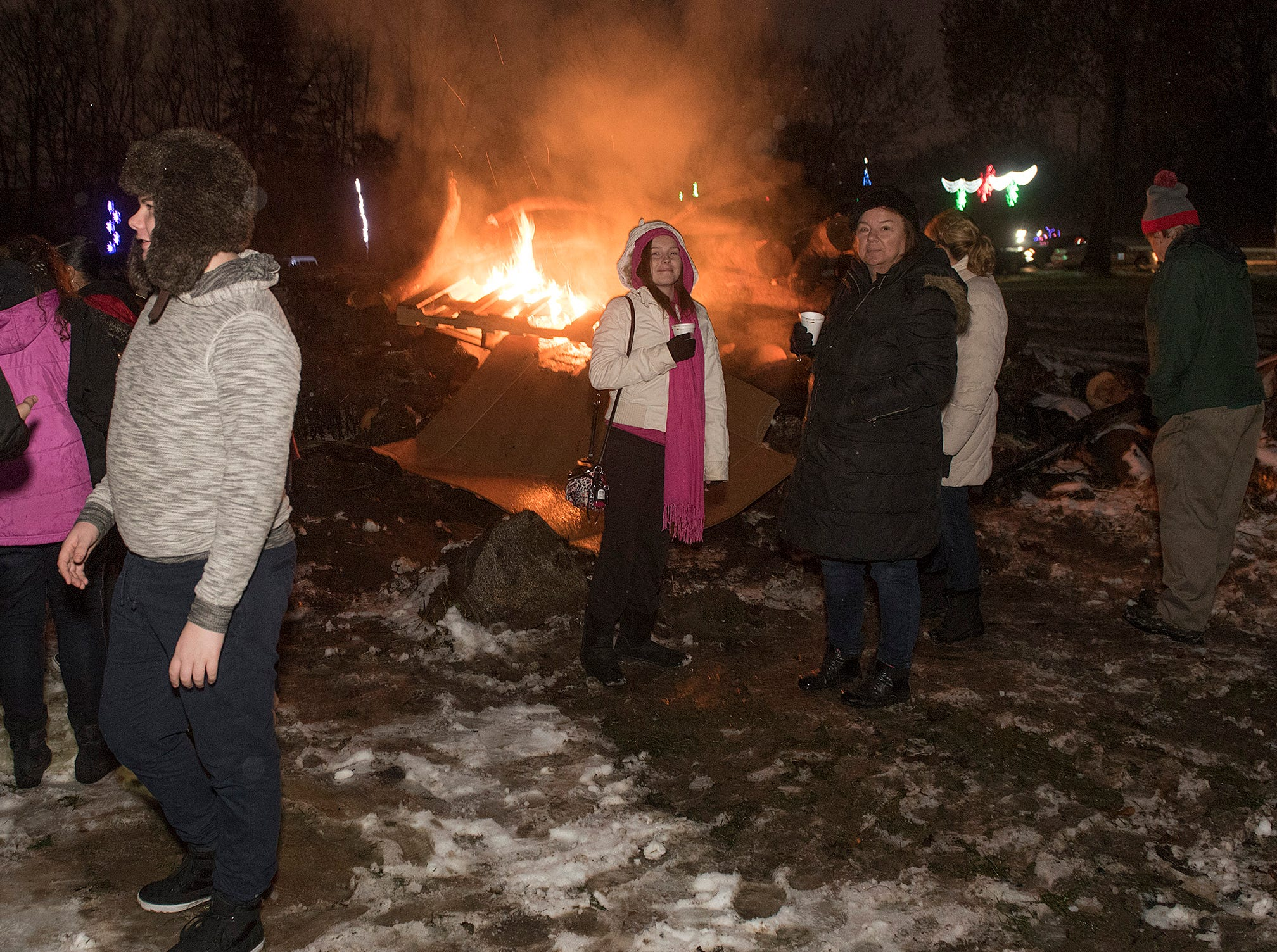 Gathering around the bonfire at the opening of Wayne County Lightfest.