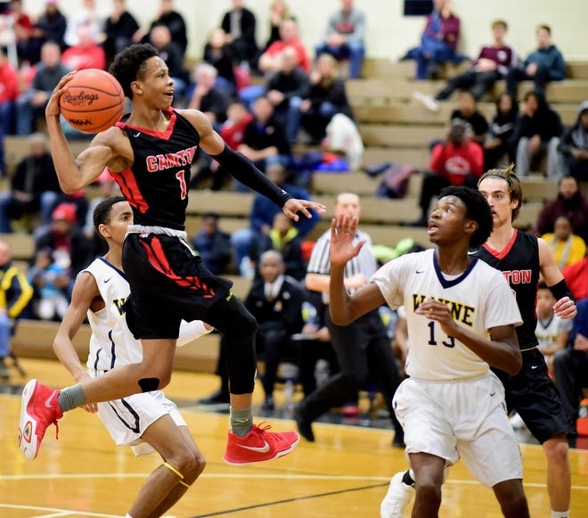 Canton point guard B. Artis White takes the ball to the basket during a game last year against Wayne Memorial.