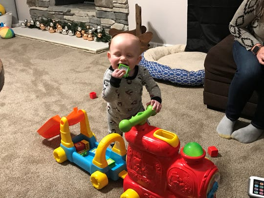 Young Ben Neuner, who turns 1 on Nov. 21, is all smiles as he plays with a toy train.