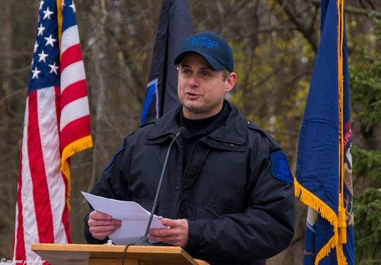 Novi Police Officer Shawn Penzak delivers the eulogy at a funeral for his retired police dog Moose.
