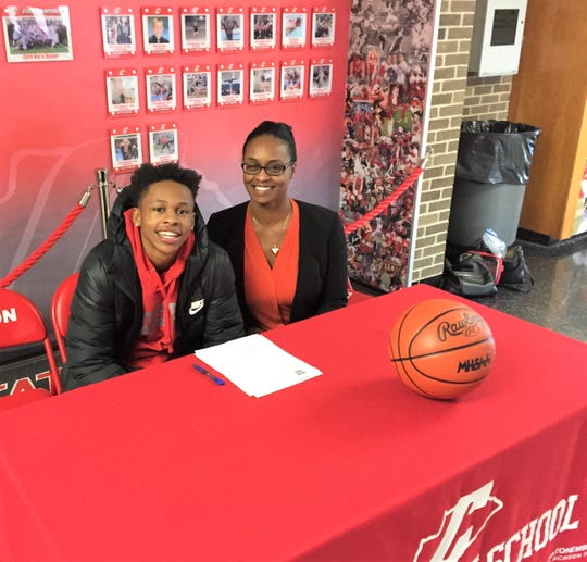 On hand for Canton guard B. Artis White's national letter-of-intent signing day was his mother Staci.