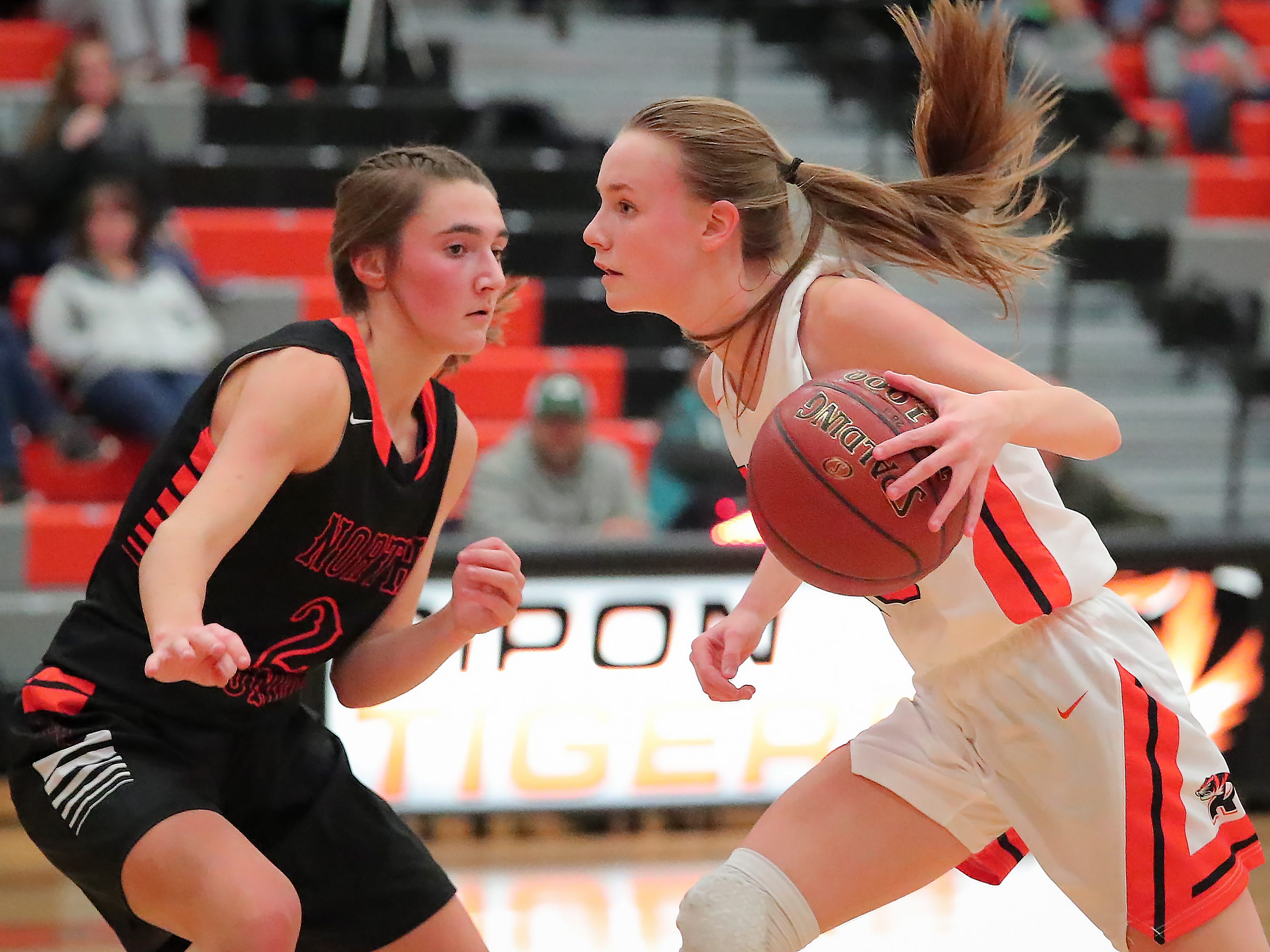 Kerstin Sauerbrei (23) of Ripon tries to get around Ashley Now (2) of North Fond du Lac. The Ripon Tigers hosted the North Fond du Lac Orioles in a non-conference basketball game Thursday evening, November 15, 2018.