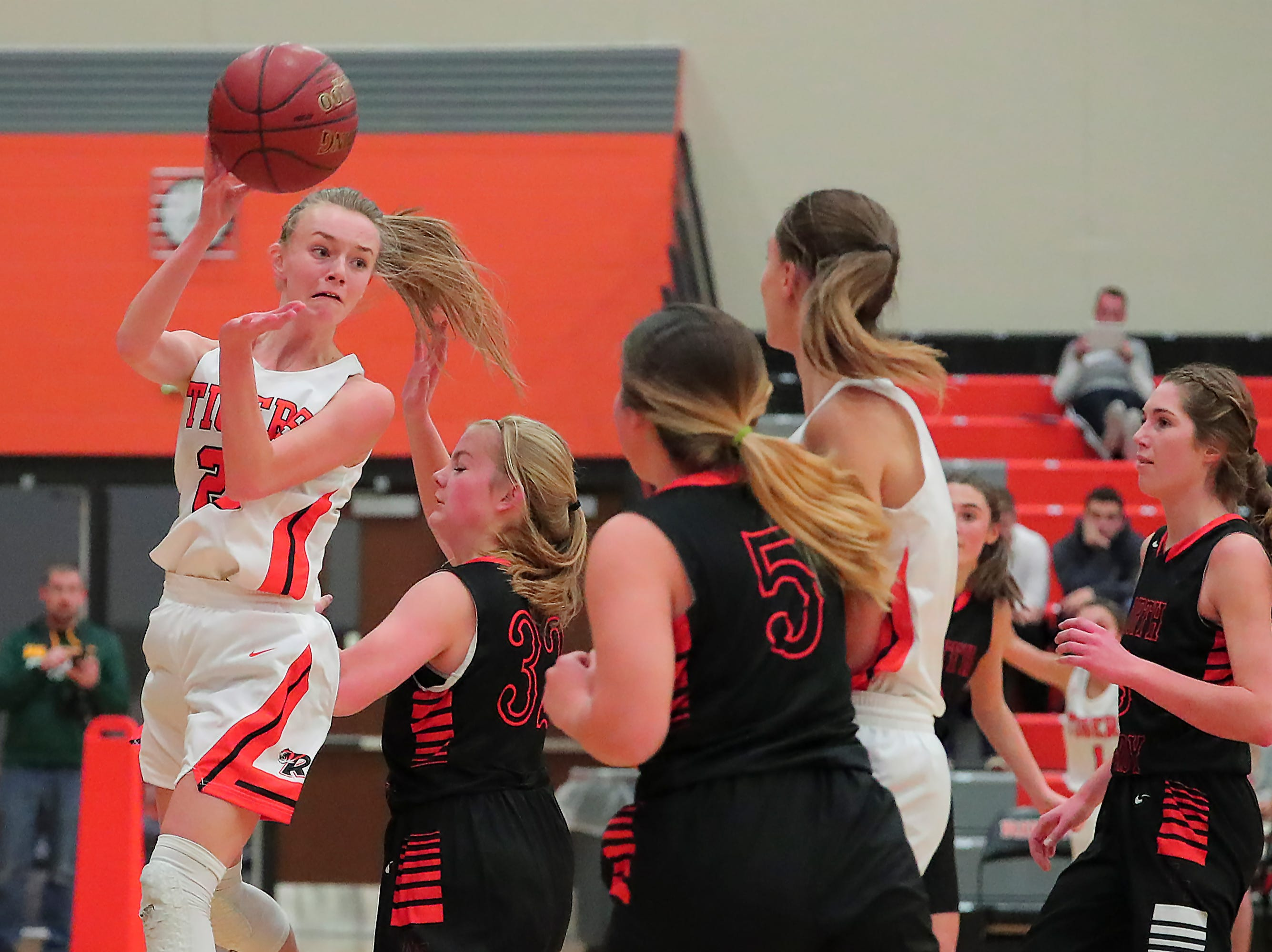 Kerstin Sauerbrei (23) of Ripon passes the ball to Lexi Miller (11) in the first half. The Ripon Tigers hosted the North Fond du Lac Orioles in a non-conference basketball game Thursday evening, November 15, 2018.