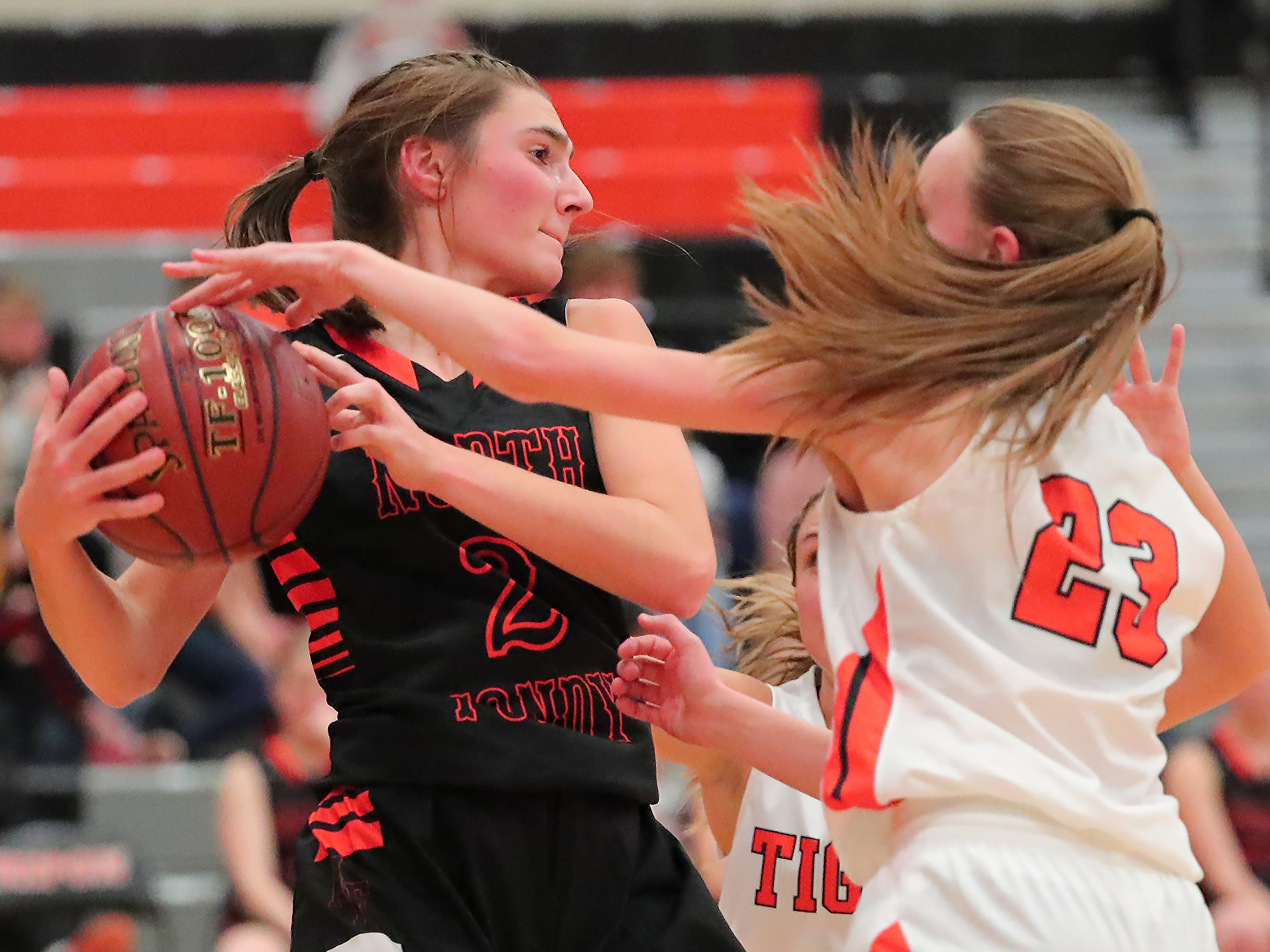 Ashley Now (2) of North Fond du Lac and Kerstin Sauerbrei (23) fight for a rebound. The Ripon Tigers hosted the North Fond du Lac Orioles in a non-conference basketball game Thursday evening, November 15, 2018.