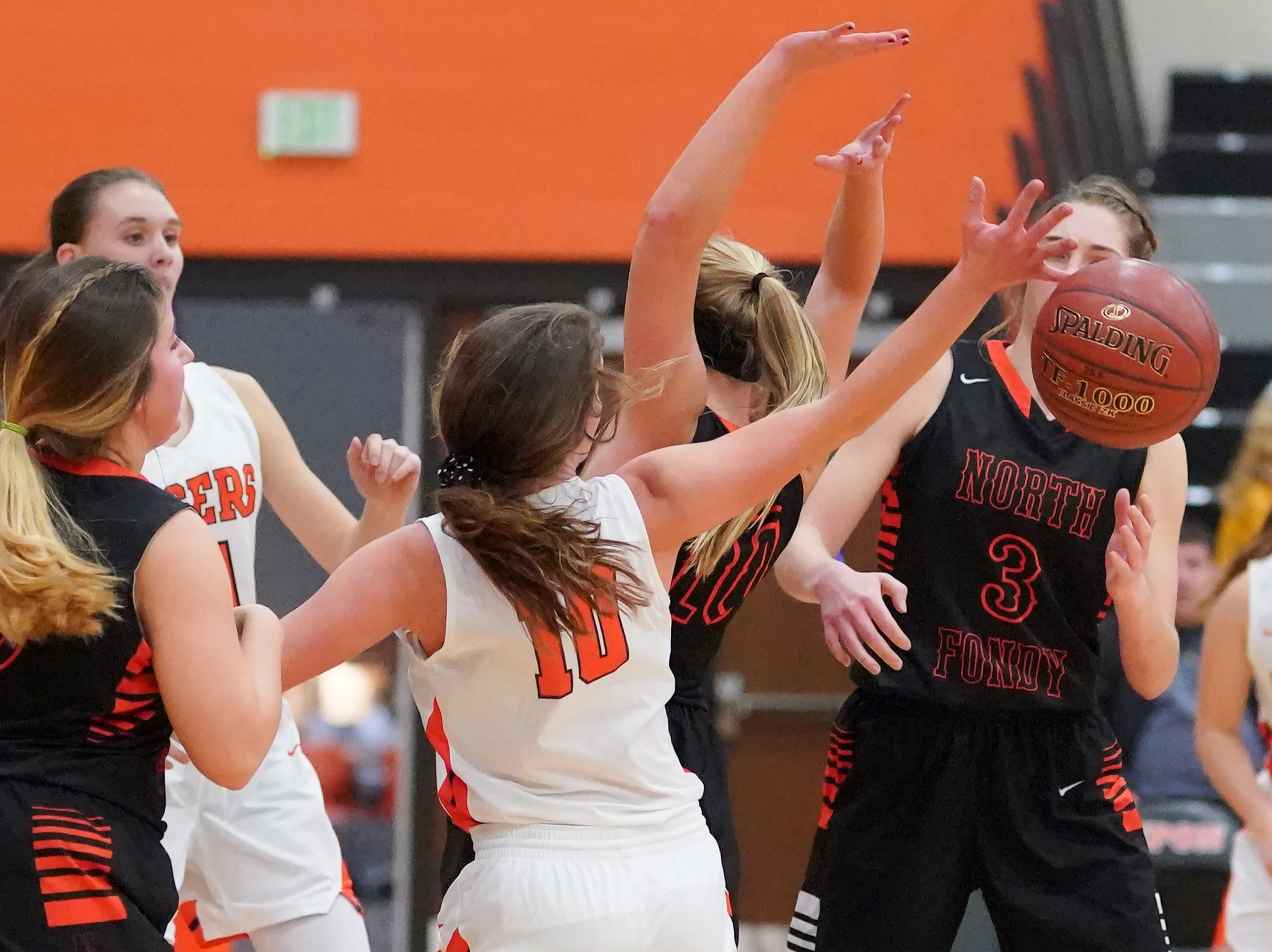 Grace Rauch (10) of Ripon reaches for a rebound. The Ripon Tigers hosted the North Fond du Lac Orioles in a non-conference basketball game Thursday evening, November 15, 2018.