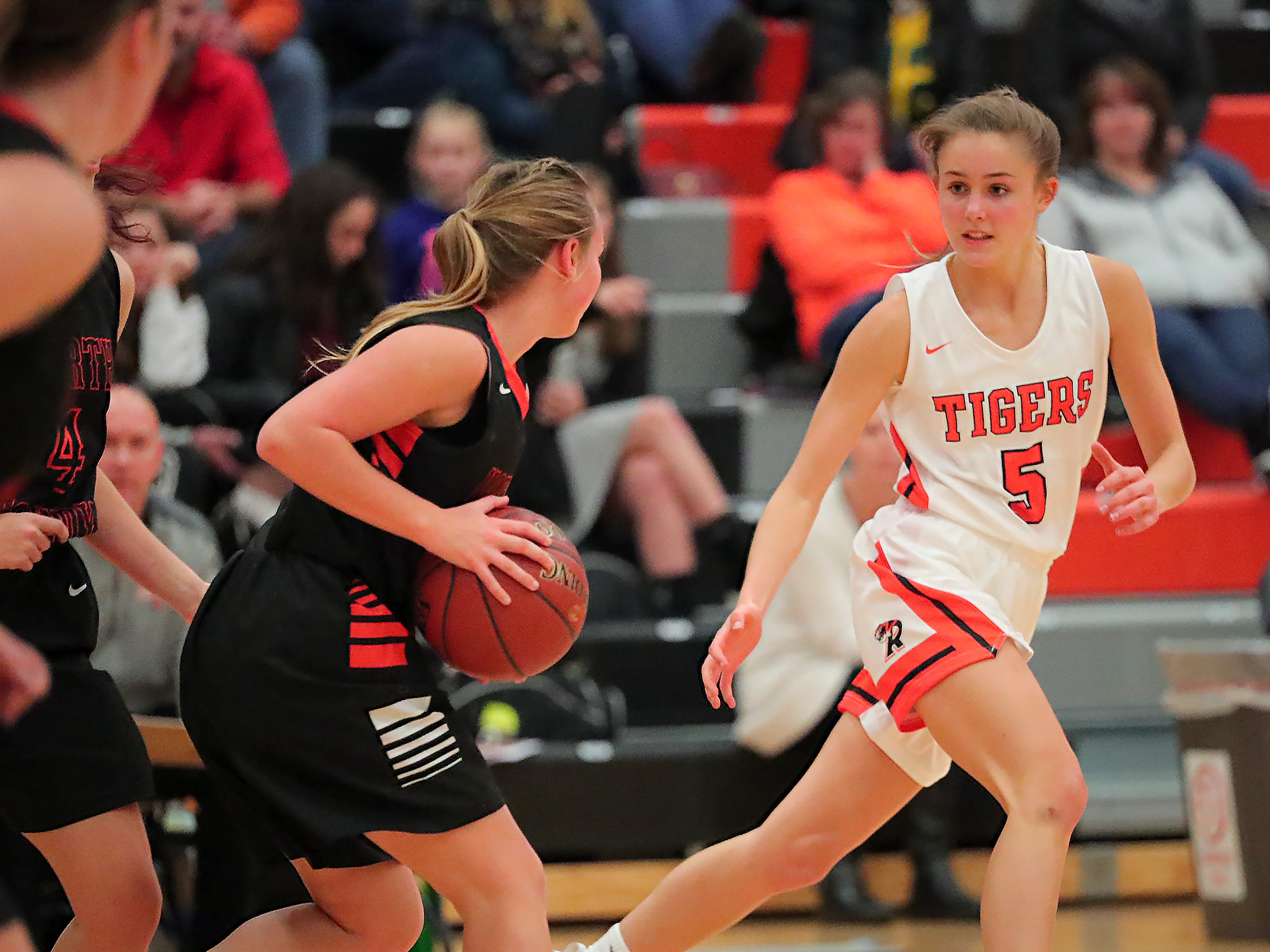 Hadley Neper (5) of Ripon keeps her eye on the ball. The Ripon Tigers hosted the North Fond du Lac Orioles in a non-conference basketball game Thursday evening, November 15, 2018.