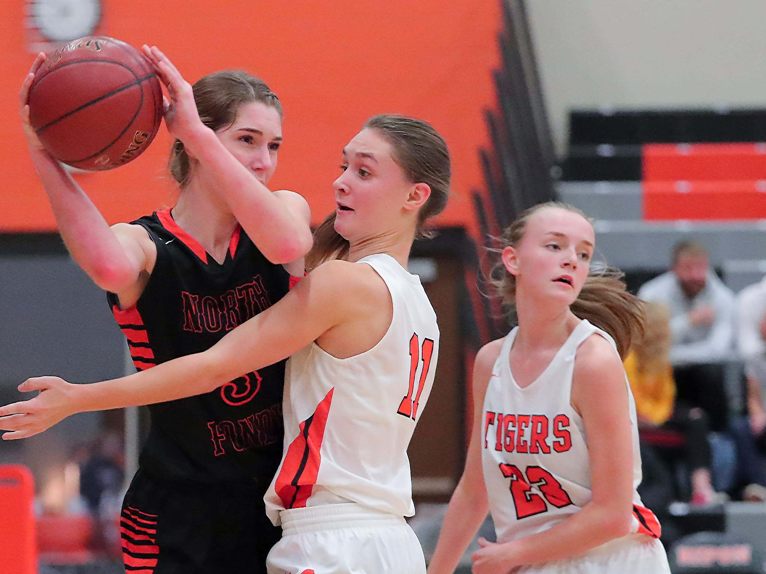 Rebecca Kingsland (3) of North Fond du Lac tries to get the ball past Lexi Miller (11) of Ripon. The Ripon Tigers hosted the North Fond du Lac Orioles in a non-conference basketball game Thursday evening, November 15, 2018.