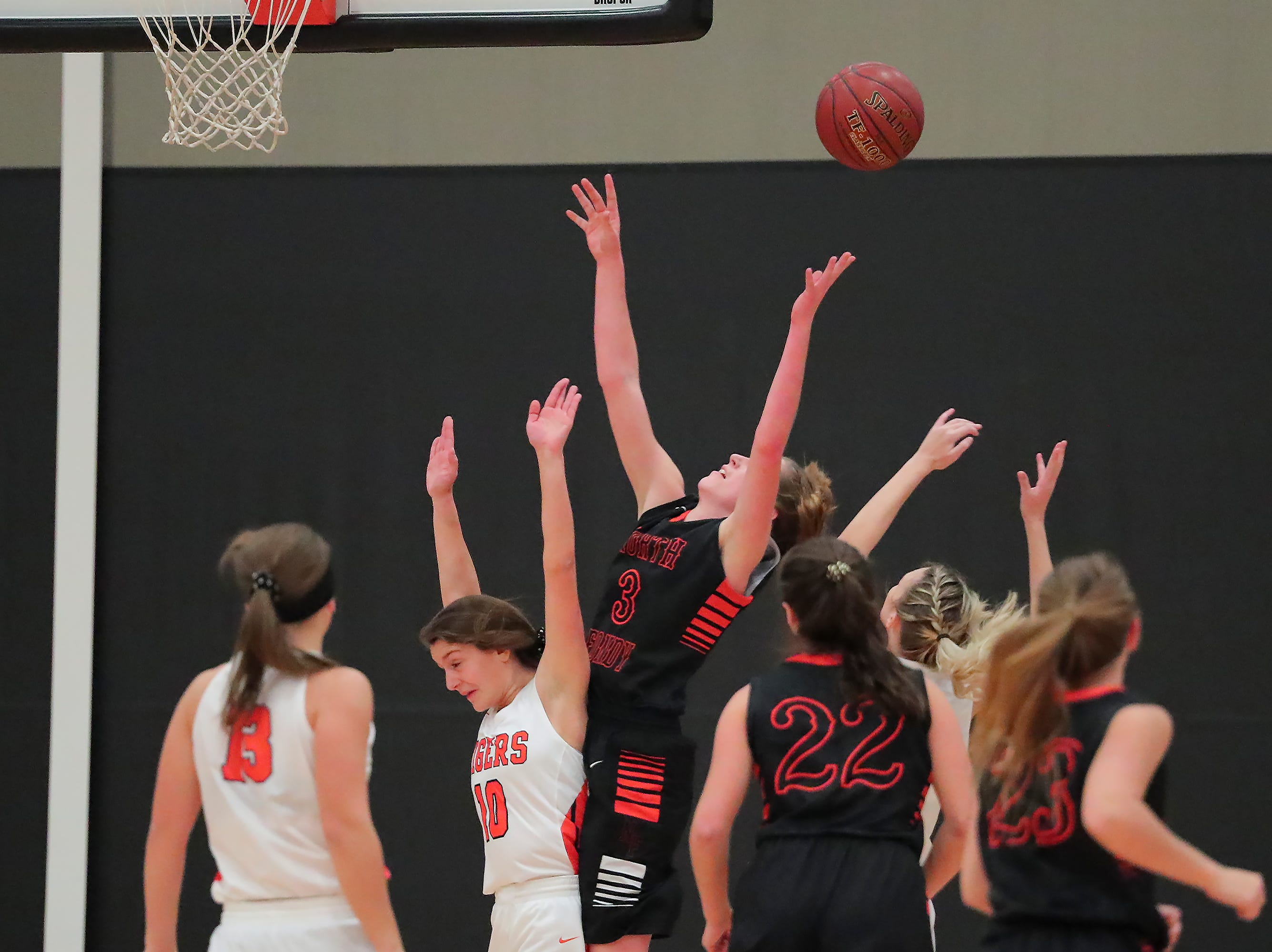 Rebecca Kingsland (3) of North Fond du Lac reaches for a rebound. The Ripon Tigers hosted the North Fond du Lac Orioles in a non-conference basketball game Thursday evening, November 15, 2018.