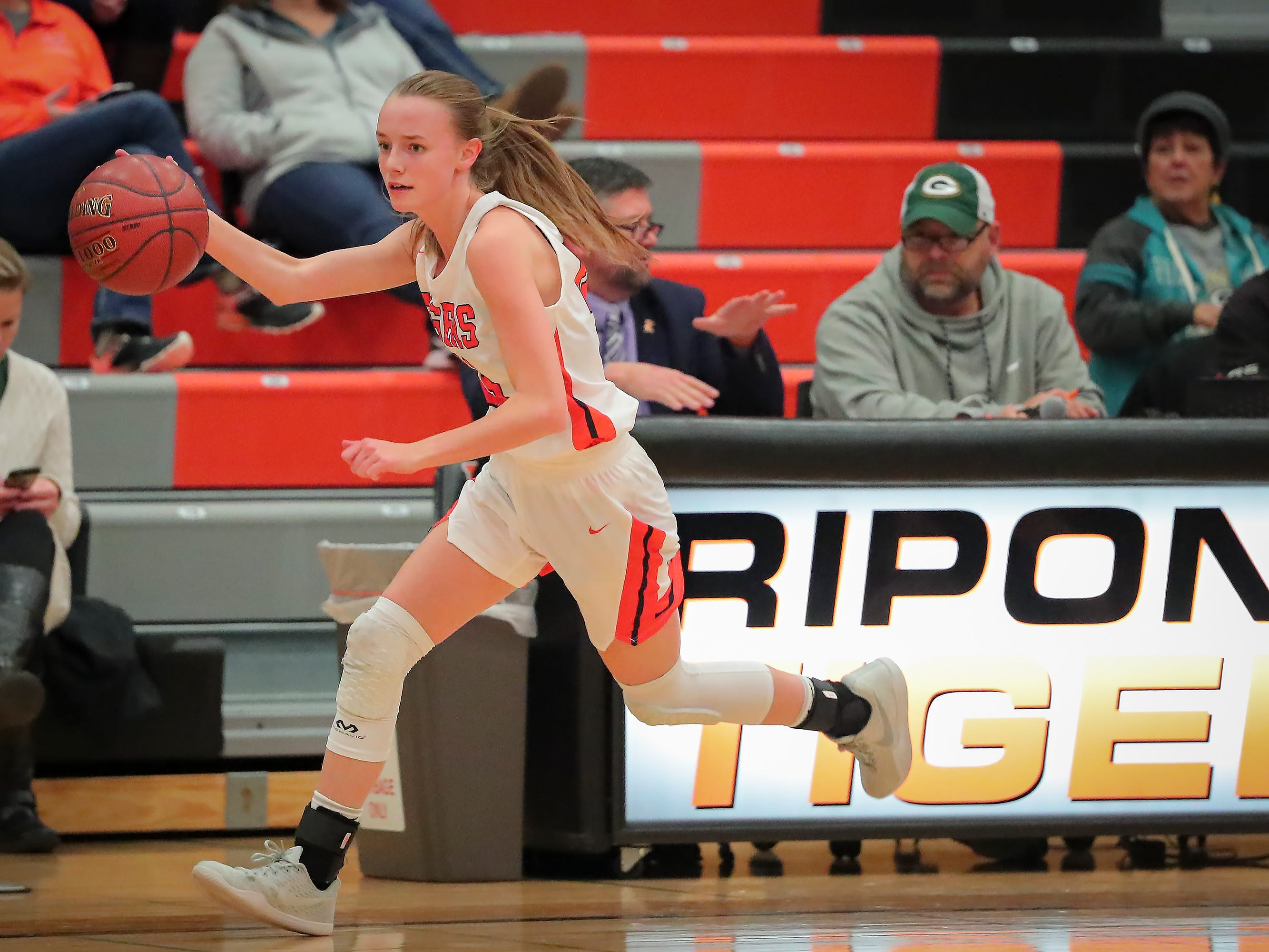 Kerstin Sauerbrei (23) of Ripon drives to the basket after stealing the ball. The Ripon Tigers hosted the North Fond du Lac Orioles in a non-conference basketball game Thursday evening, November 15, 2018.