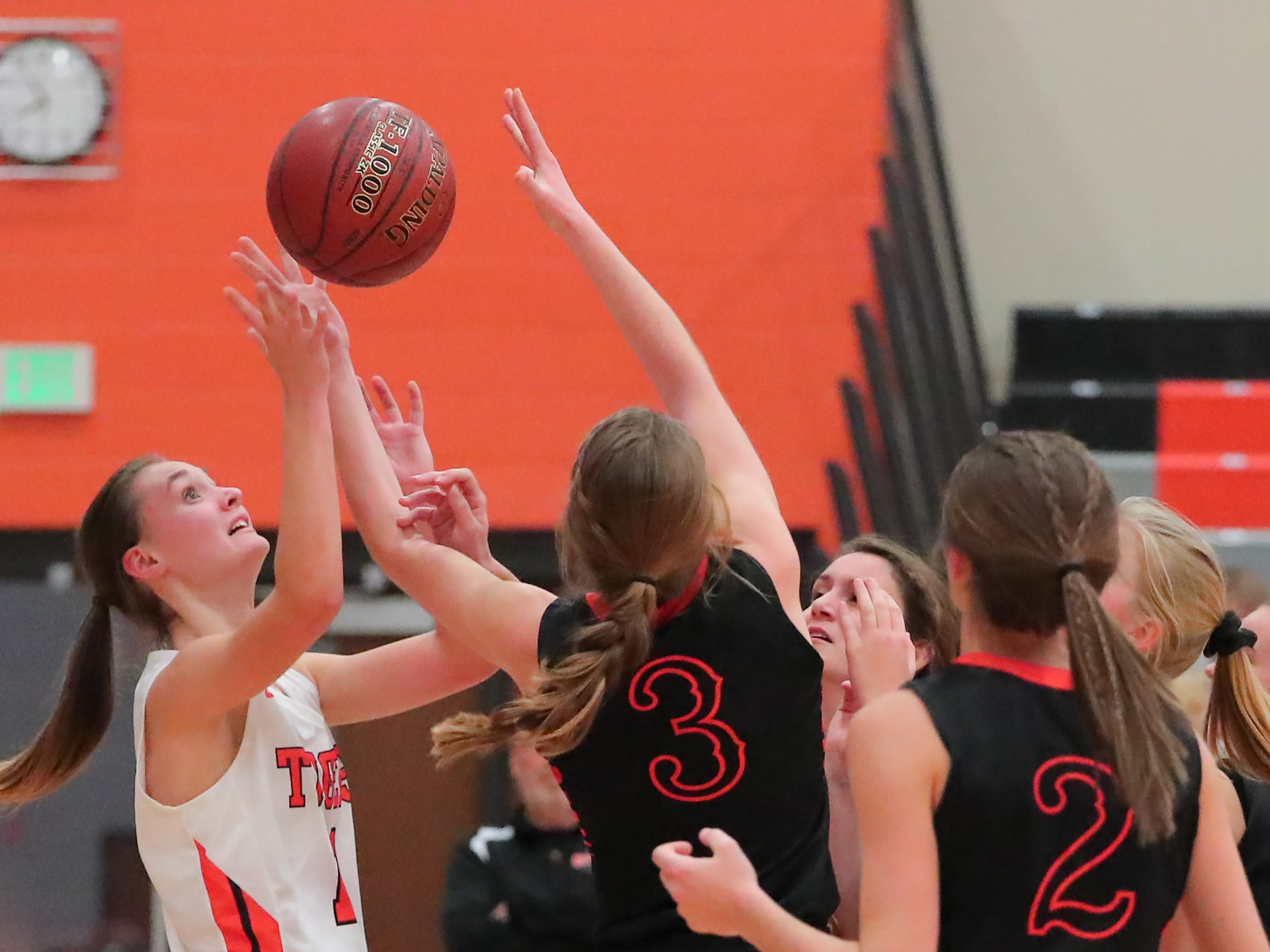 Lexi Miller (11) of Ripon and Rebecca Kingsland (3) of North Fond du Lac fight for a rebound. The Ripon Tigers hosted the North Fond du Lac Orioles in a non-conference basketball game Thursday evening, November 15, 2018.