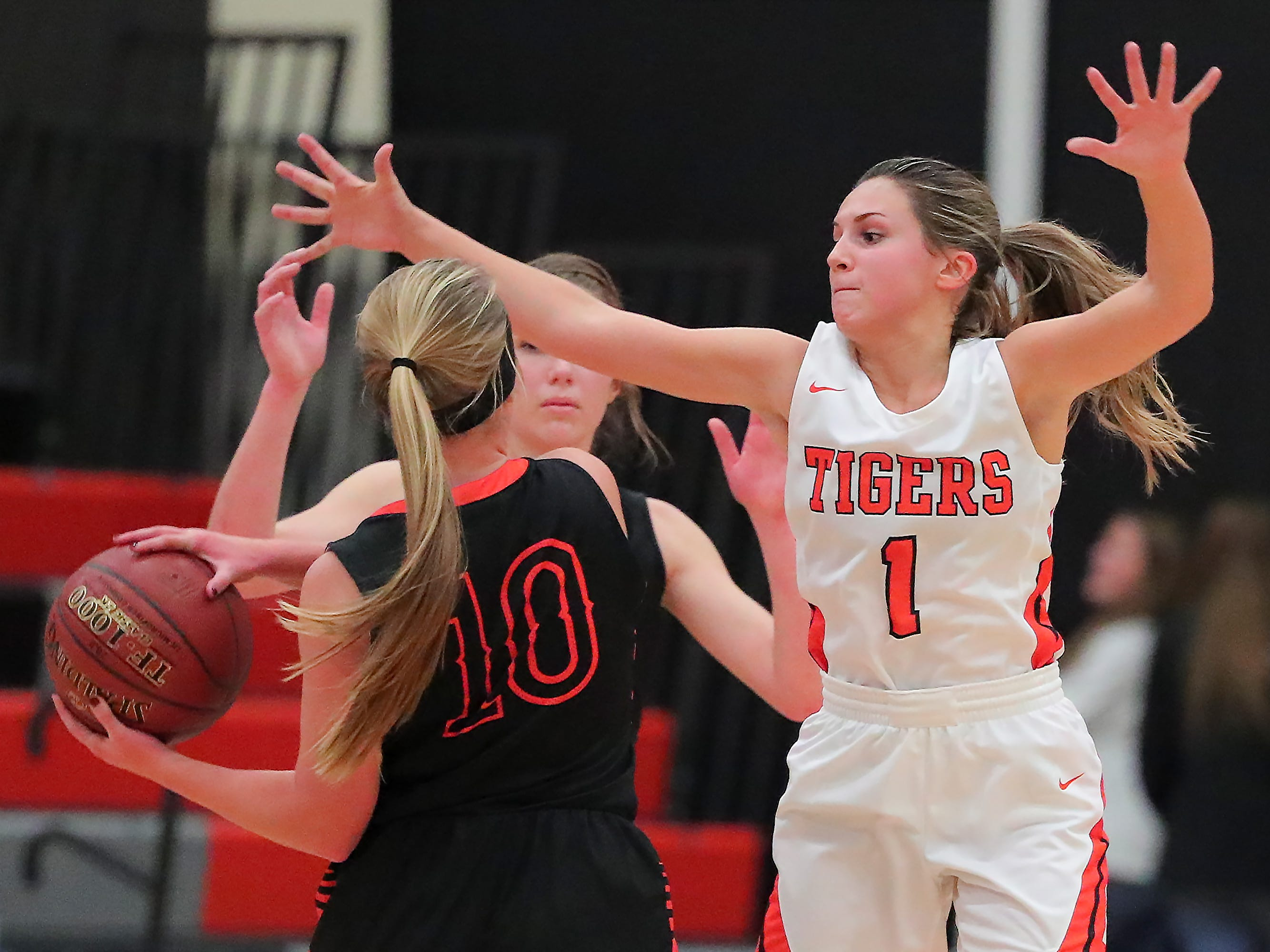 Maria Meincke (1) of Ripon tries to block Karlee Lamb (10) of North Fond du Lac. The Ripon Tigers hosted the North Fond du Lac Orioles in a non-conference basketball game Thursday evening, November 15, 2018.