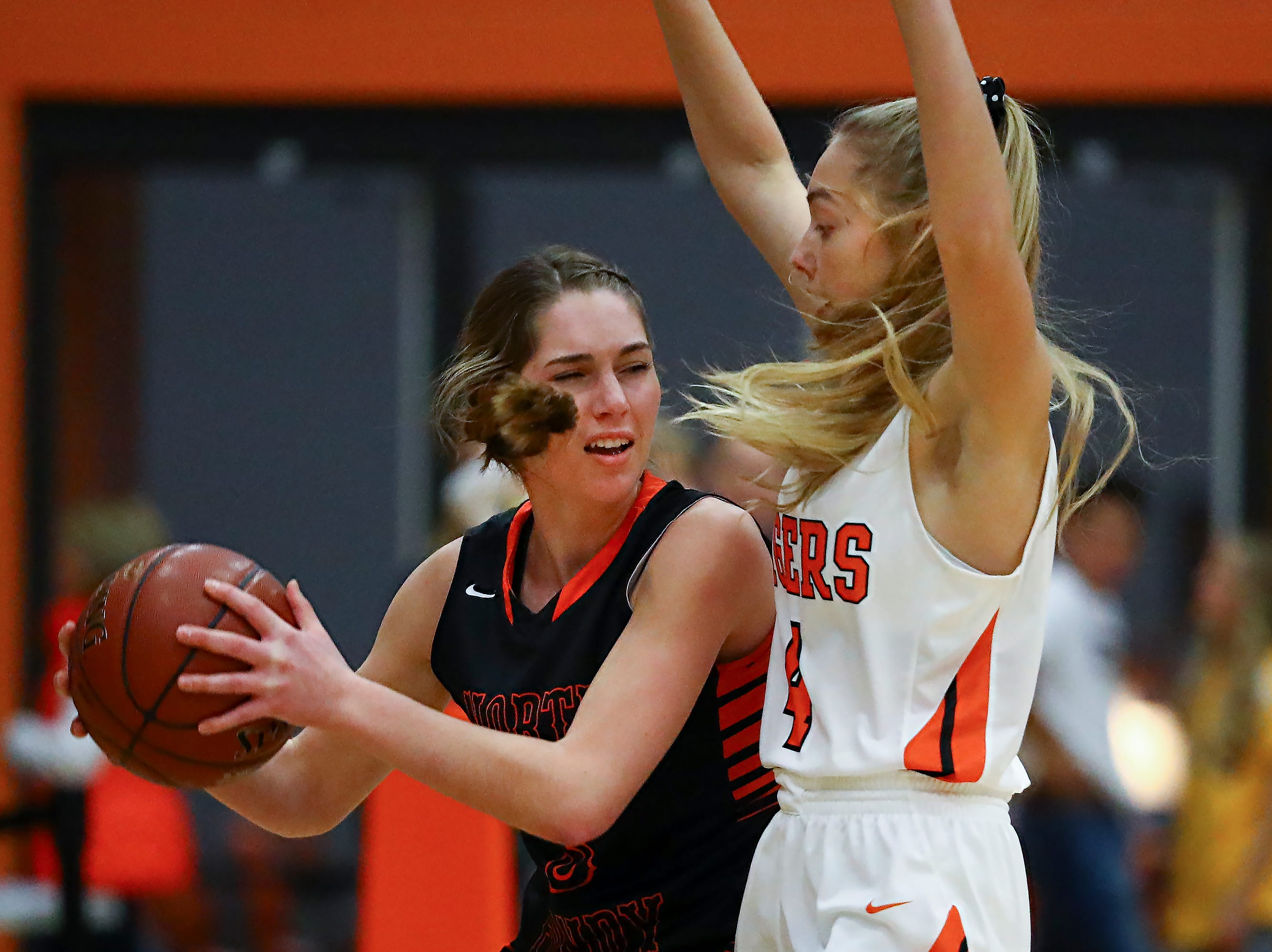 Rebecca Kingsland (3) of North Fond du Lac and Elle Lewis (4) of Ripon battle for the ball. The Ripon Tigers hosted the North Fond du Lac Orioles in a non-conference basketball game Thursday evening, November 15, 2018.