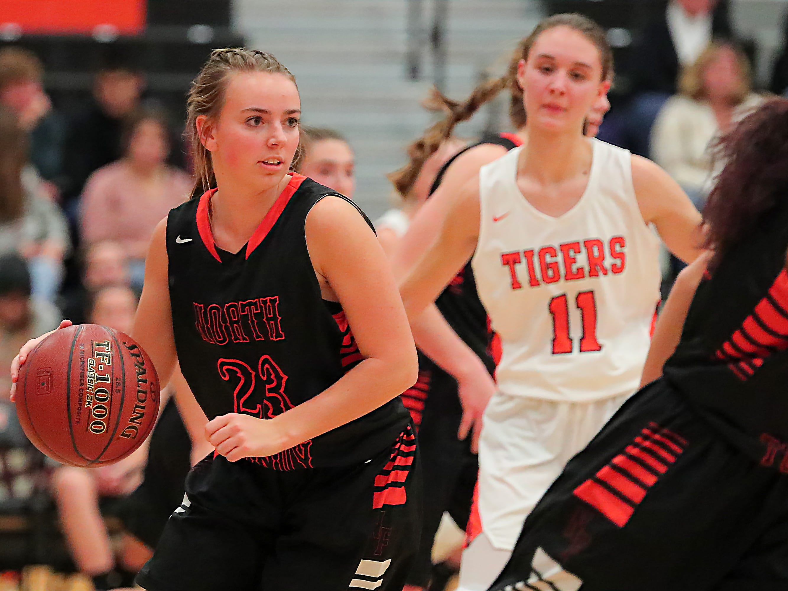 Jordyn Stettbacher (23) of North Fond du Lac looks for someone to pass the ball. The Ripon Tigers hosted the North Fond du Lac Orioles in a non-conference basketball game Thursday evening, November 15, 2018.