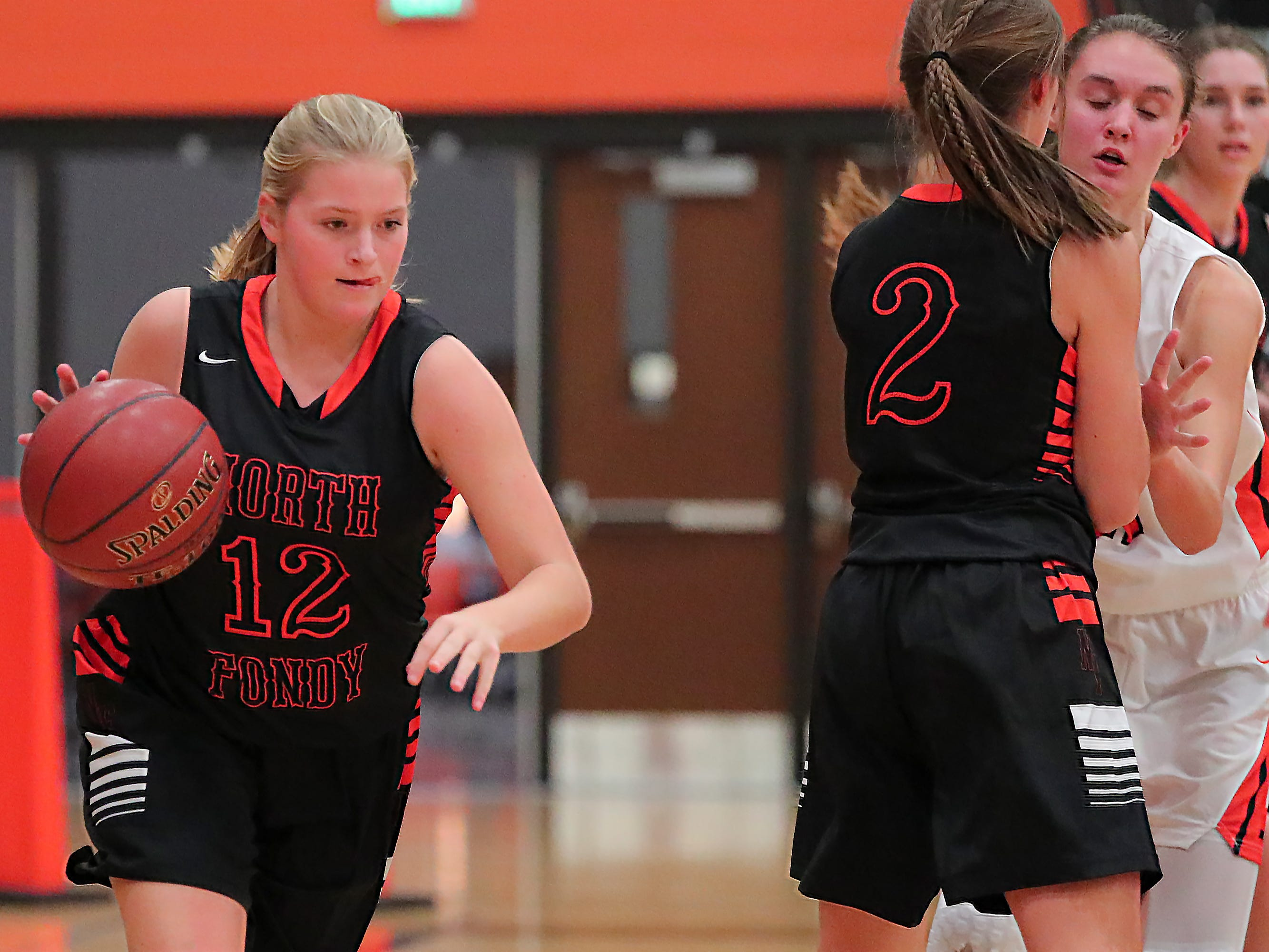 Bree Rock (12) of North Fond du Lac moves the ball down court. The Ripon Tigers hosted the North Fond du Lac Orioles in a non-conference basketball game Thursday evening, November 15, 2018.