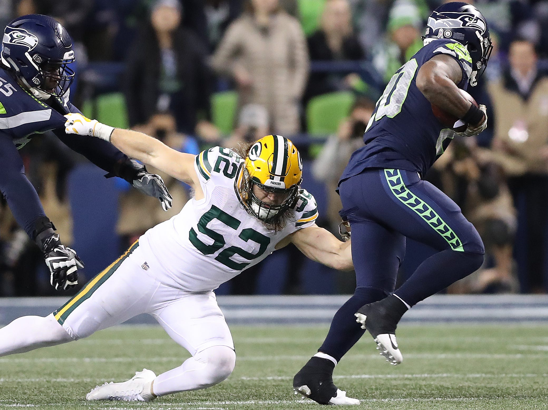 Green Bay Packers outside linebacker Clay Matthews (52) tries to tackle running back Rashaad Penny (20) against the Seattle Seahawks at CenturyLink Field Thursday, November 15, 2018 in Seattle, WA. Jim Matthews/USA TODAY NETWORK-Wis