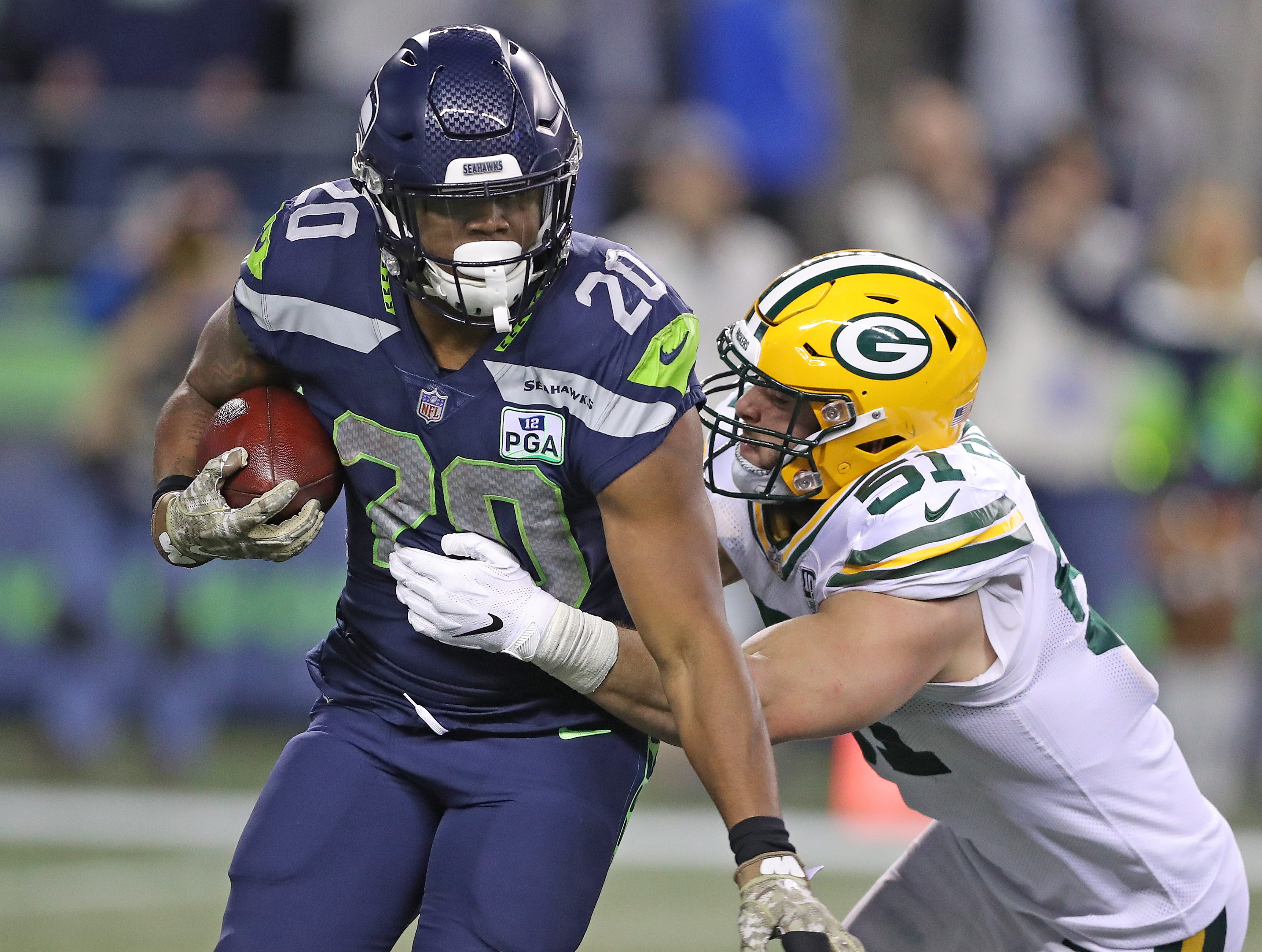 Green Bay Packers linebacker Kyler Fackrell (51) tackles running back Rashaad Penny (20) against the Seattle Seahawks at CenturyLink Field Thursday, November 15, 2018 in Seattle, WA. Jim Matthews/USA TODAY NETWORK-Wis