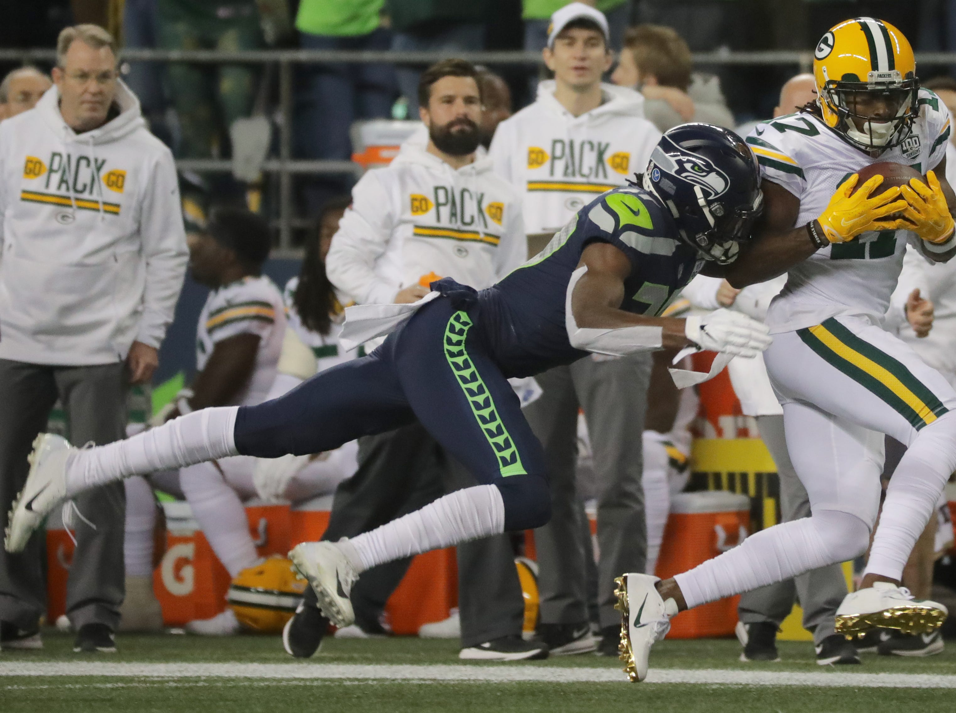 Green Bay Packers wide receiver Davante Adams (17) picks up 41-yards in a reception while being covered by Seattle Seahawks cornerback Tre Flowers (37) during the first quarter of their game Thursday, November 25, 2018 at CenturyLink Field in Seattle, Wash.