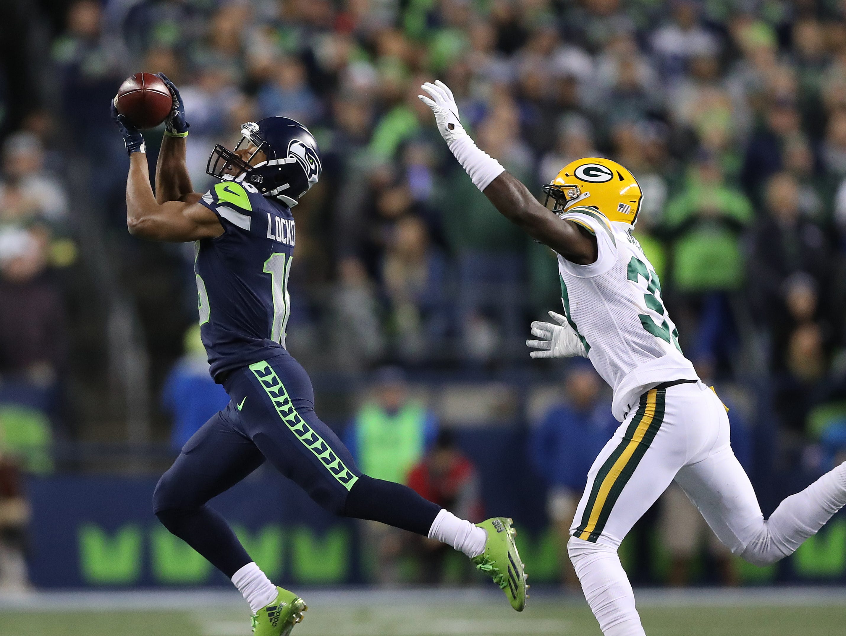 Green Bay Packers cornerback Josh Jackson (37) gets brat on a pass play to wide receiver Tyler Lockett (16) against the Seattle Seahawks at CenturyLink Field Thursday, November 15, 2018 in Seattle, WA. Jim Matthews/USA TODAY NETWORK-Wis