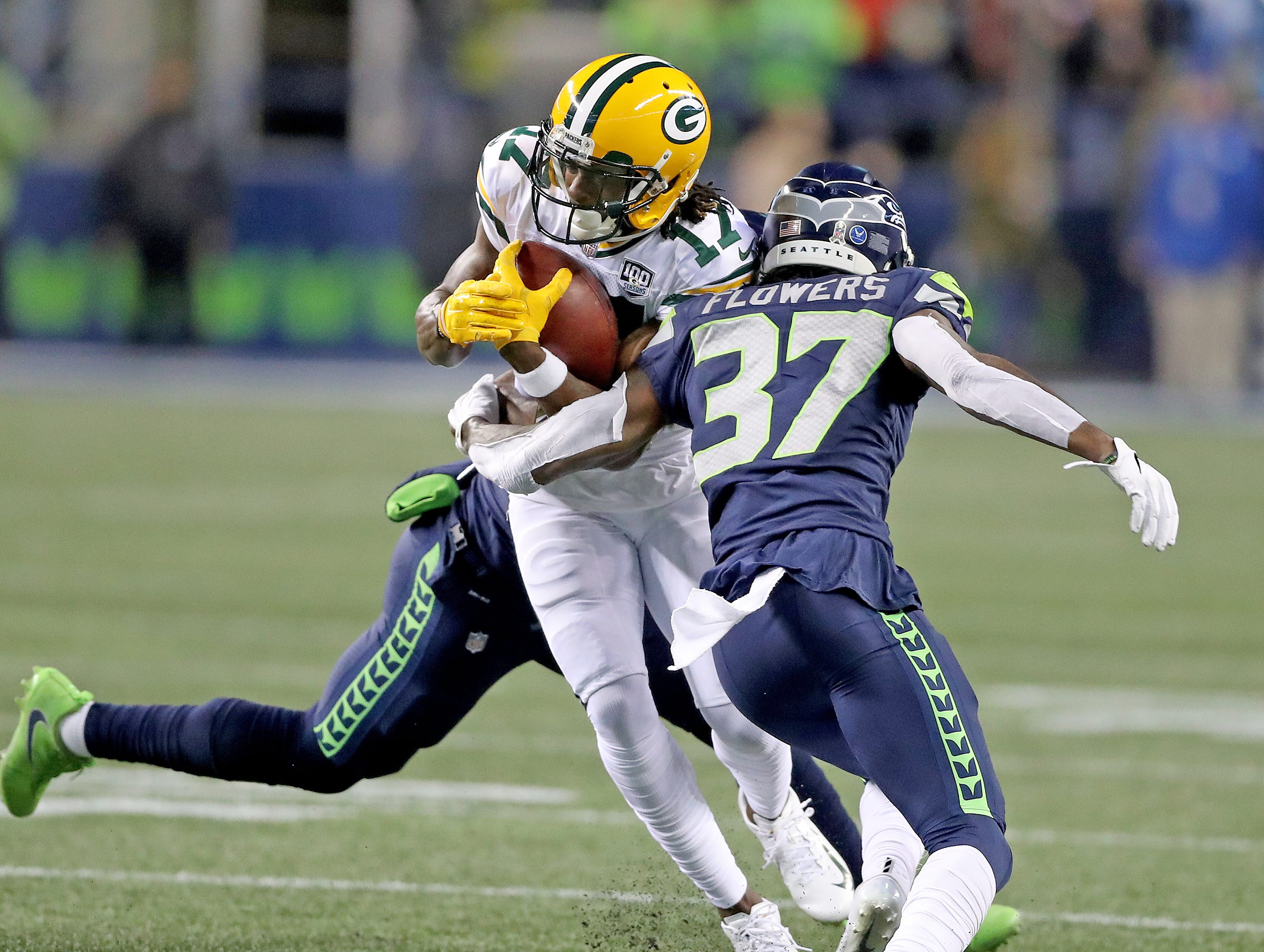 Green Bay Packers wide receiver Davante Adams (17) tries to split two defenders against the Seattle Seahawks at CenturyLink Field Thursday, November 15, 2018 in Seattle, WA. Jim Matthews/USA TODAY NETWORK-Wis