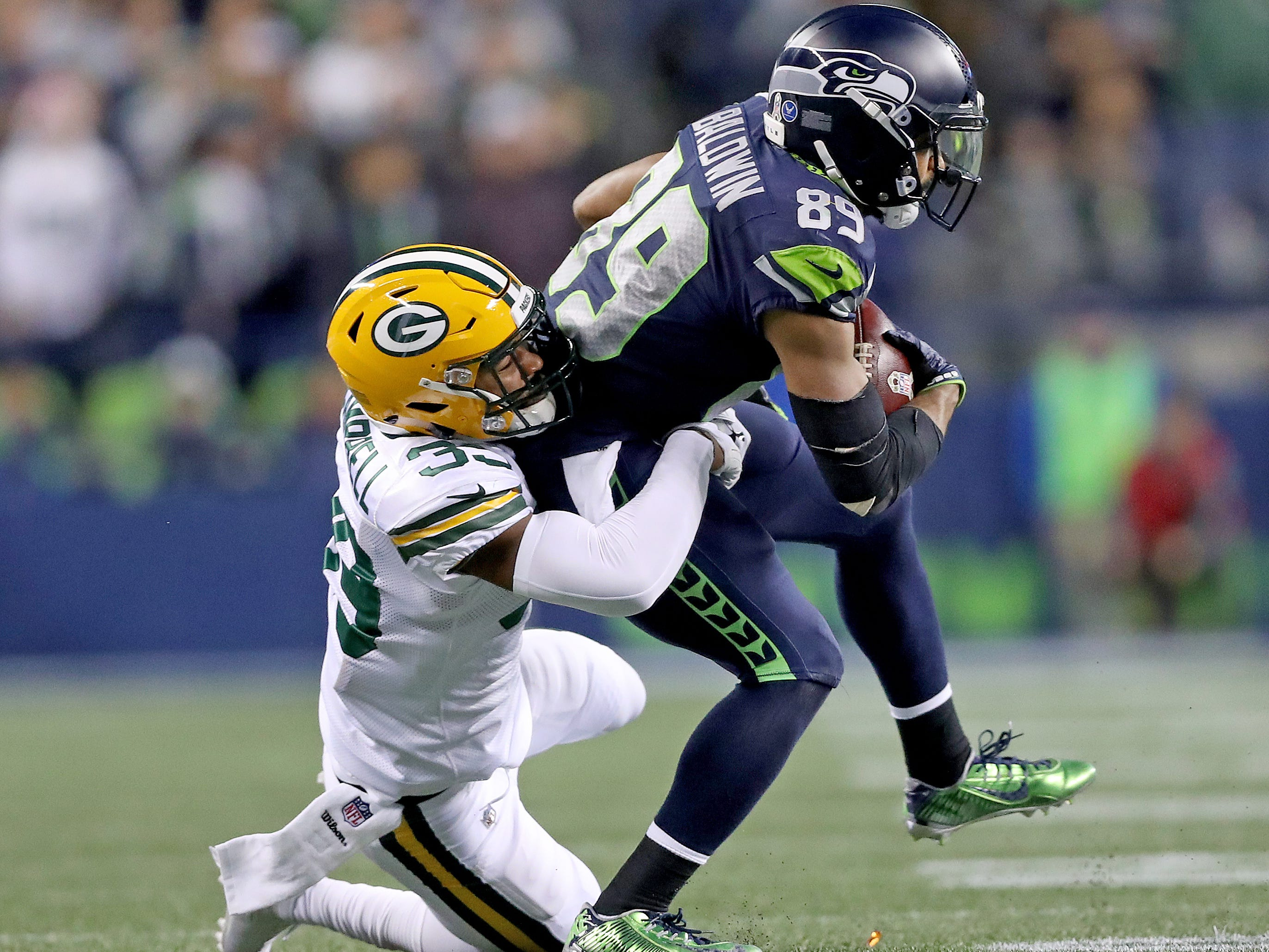Green Bay Packers defensive back Ibraheim Campbell (39) tackles wide receiver Doug Baldwin (89) against the Seattle Seahawks at CenturyLink Field Thursday, November 15, 2018 in Seattle, WA. Jim Matthews/USA TODAY NETWORK-Wis