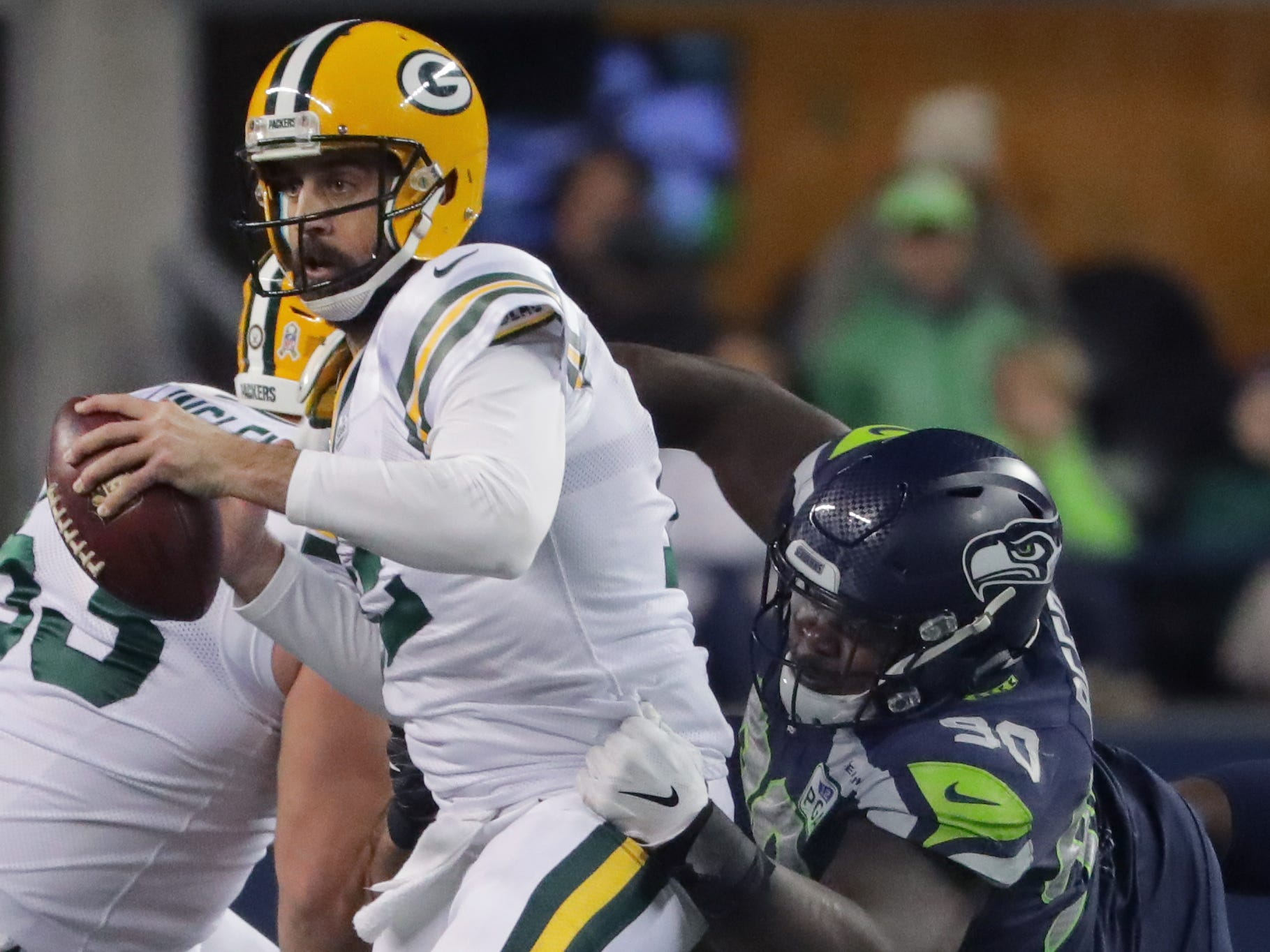 Green Bay Packers' Aaron Rodgers (12) is sacked by  Seattle Seahawks defensive tackle Jarran Reed during the third quarter of their game Thursday, November 25, 2018 at CenturyLink Field in Seattle, Wash.