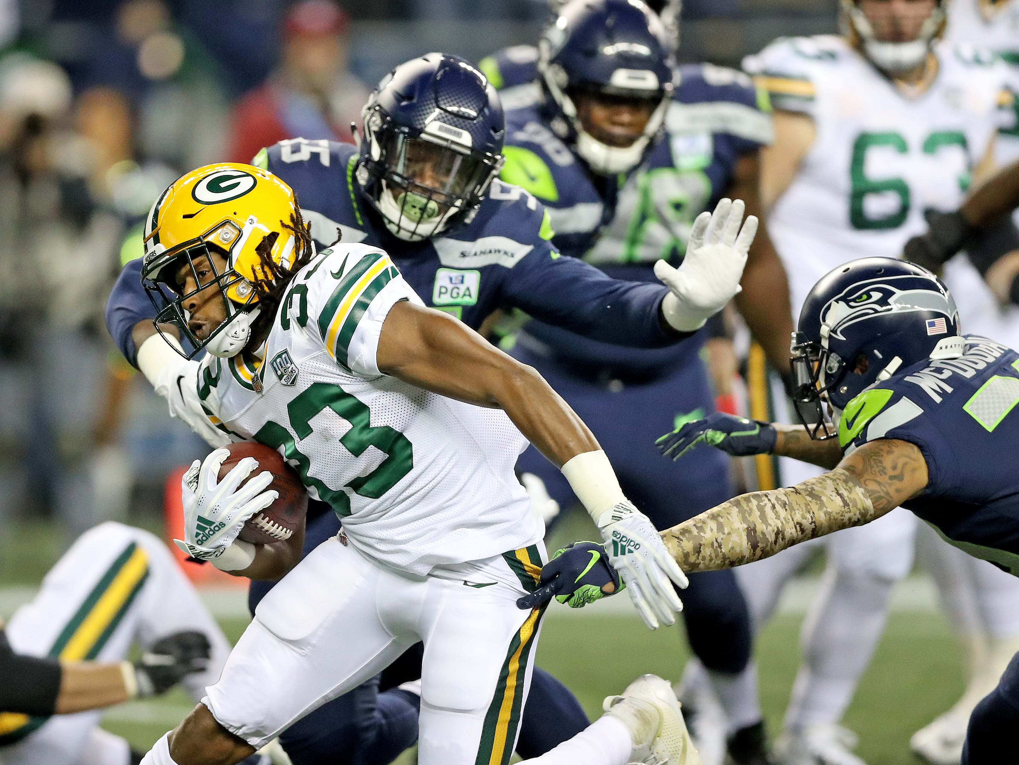 Green Bay Packers running back Aaron Jones (33) zigzags through the defense against the Seattle Seahawks at CenturyLink Field Thursday, November 15, 2018 in Seattle, WA. Jim Matthews/USA TODAY NETWORK-Wis