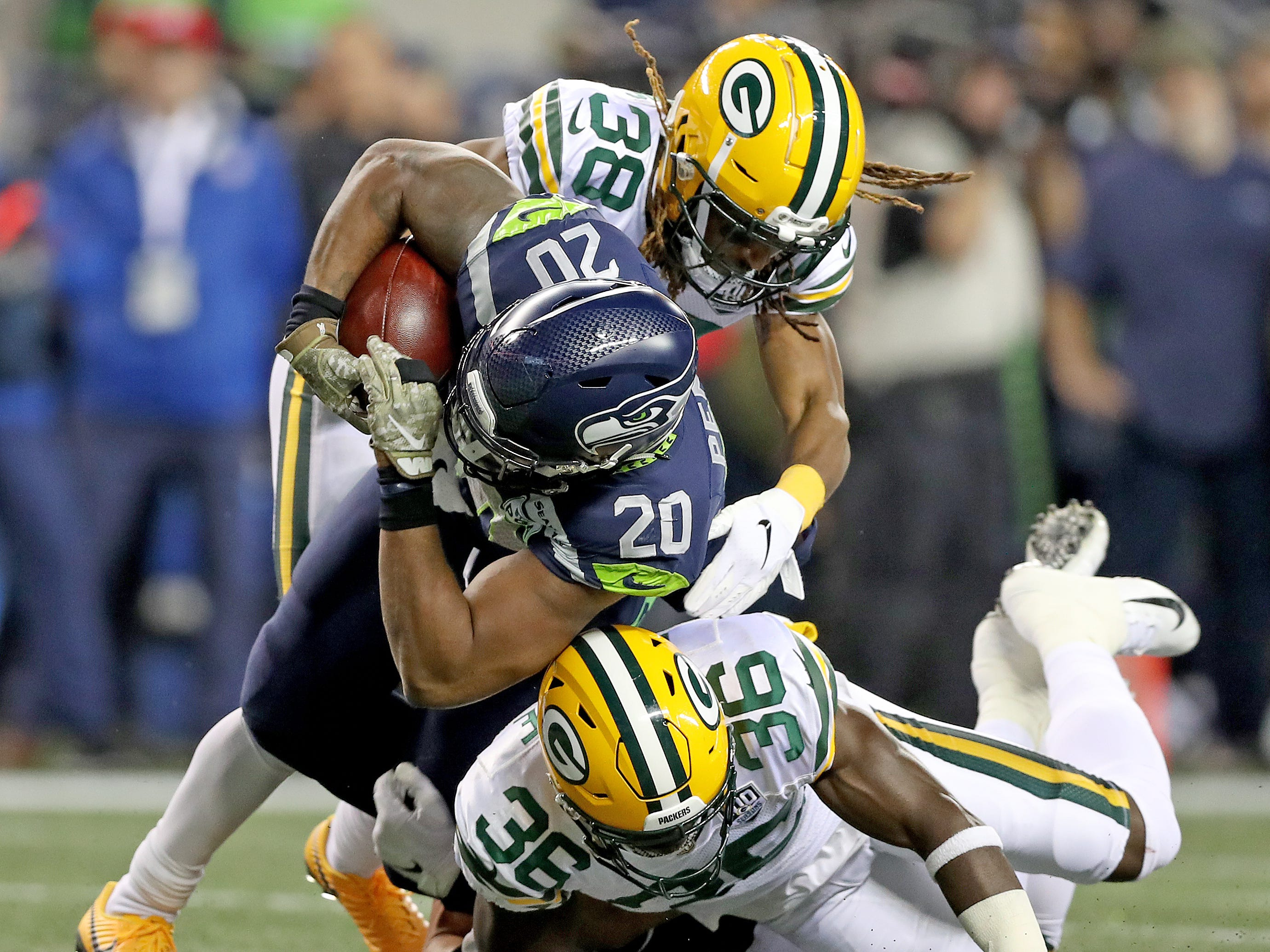 Green Bay Packers cornerback Tramon Williams (38) and defensive back Raven Greene (36) combine to tackle running back Rashaad Penny (20) against the Seattle Seahawks at CenturyLink Field Thursday, November 15, 2018 in Seattle, WA. Jim Matthews/USA TODAY NETWORK-Wis