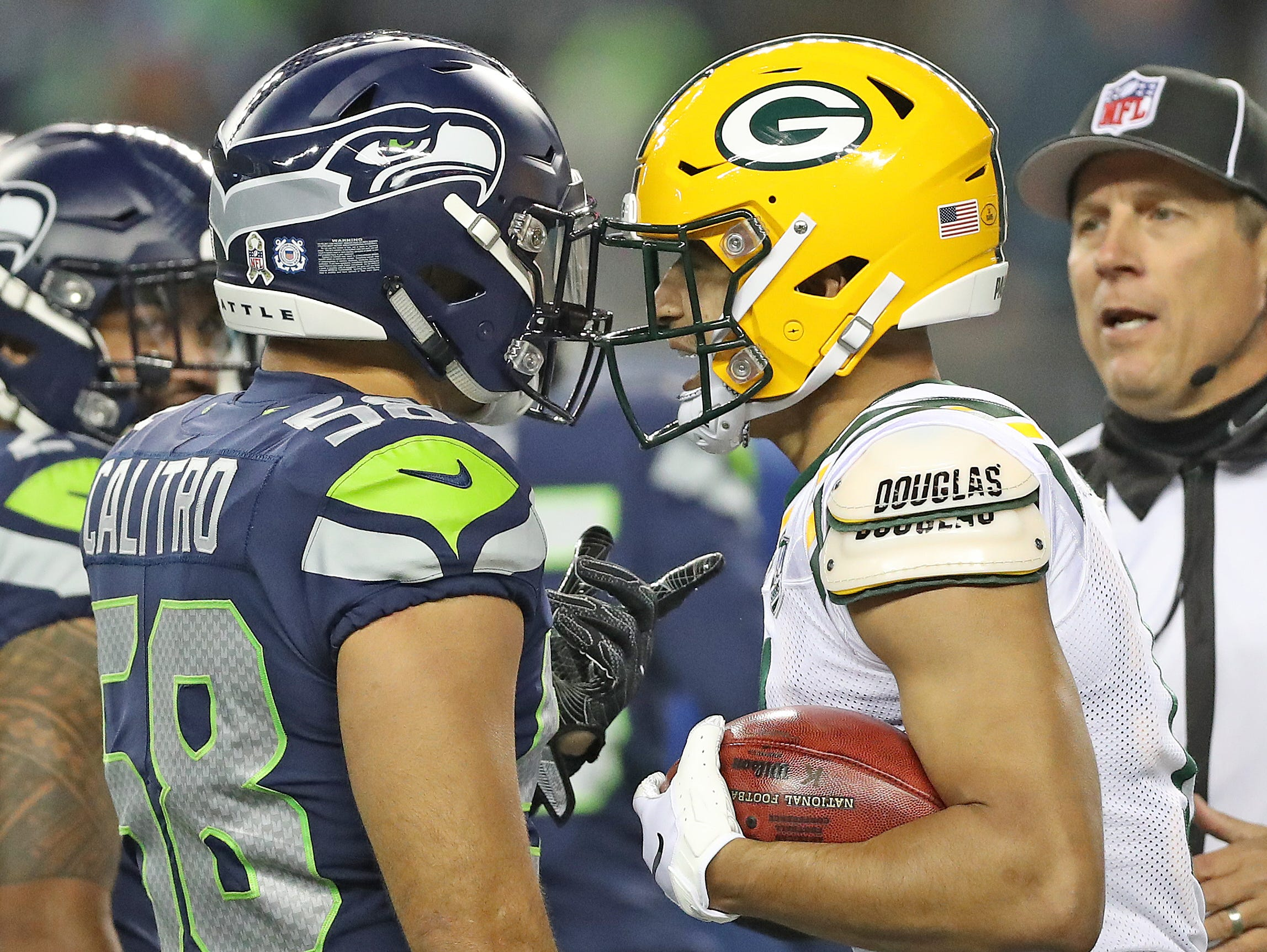 Green Bay Packers wide receiver Trevor Davis (11) confronts outside linebacker Austin Calitro (58) after a punt return against the Seattle Seahawks at CenturyLink Field Thursday, November 15, 2018 in Seattle, WA. Jim Matthews/USA TODAY NETWORK-Wis