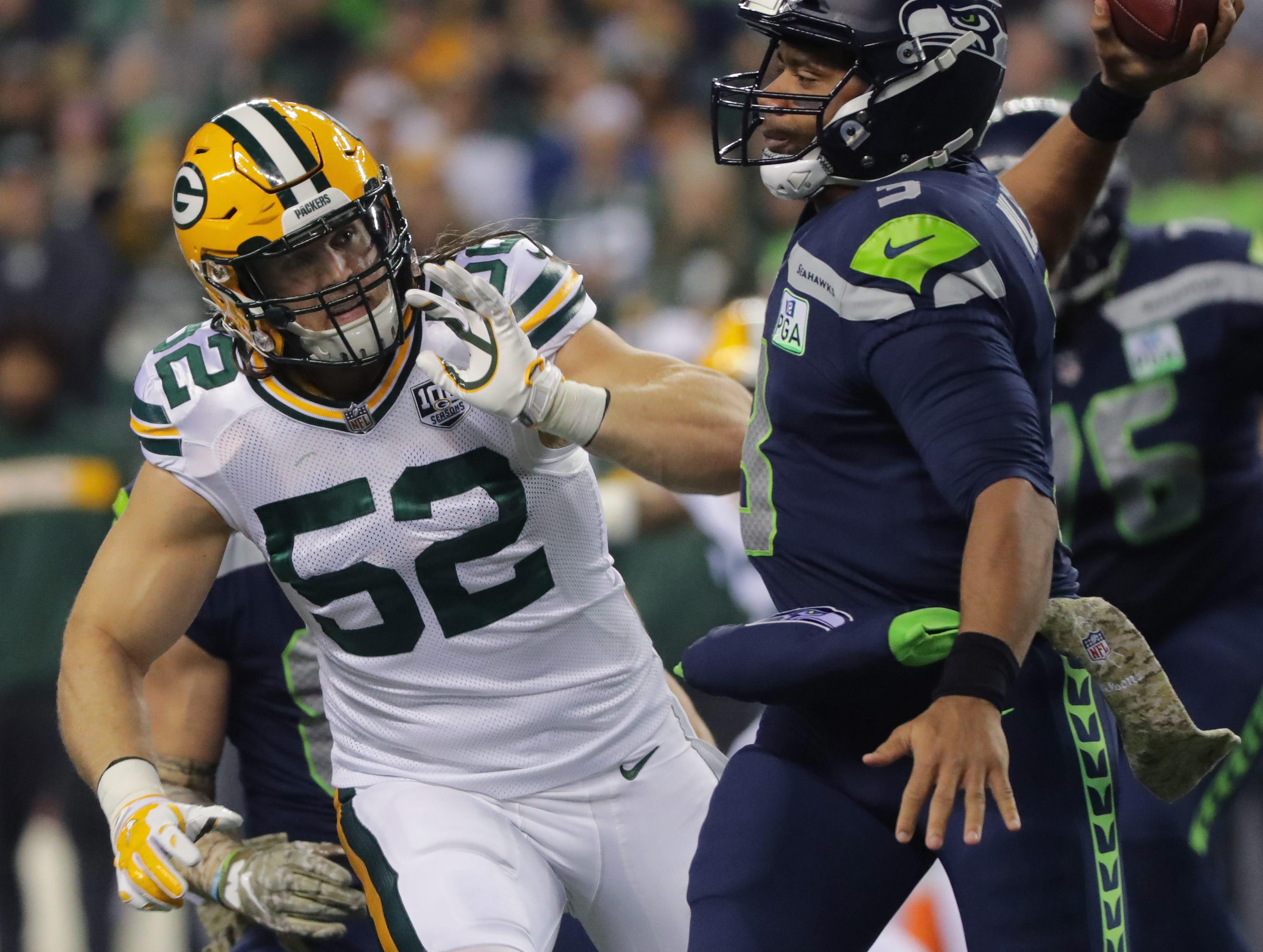 Seattle Seahawks quarterback Russell Wilson (3) is pressured by Green Bay Packers outside linebacker Clay Matthews (52) during the first quarter of their game Thursday, November 25, 2018 at CenturyLink Field in Seattle, Wash.