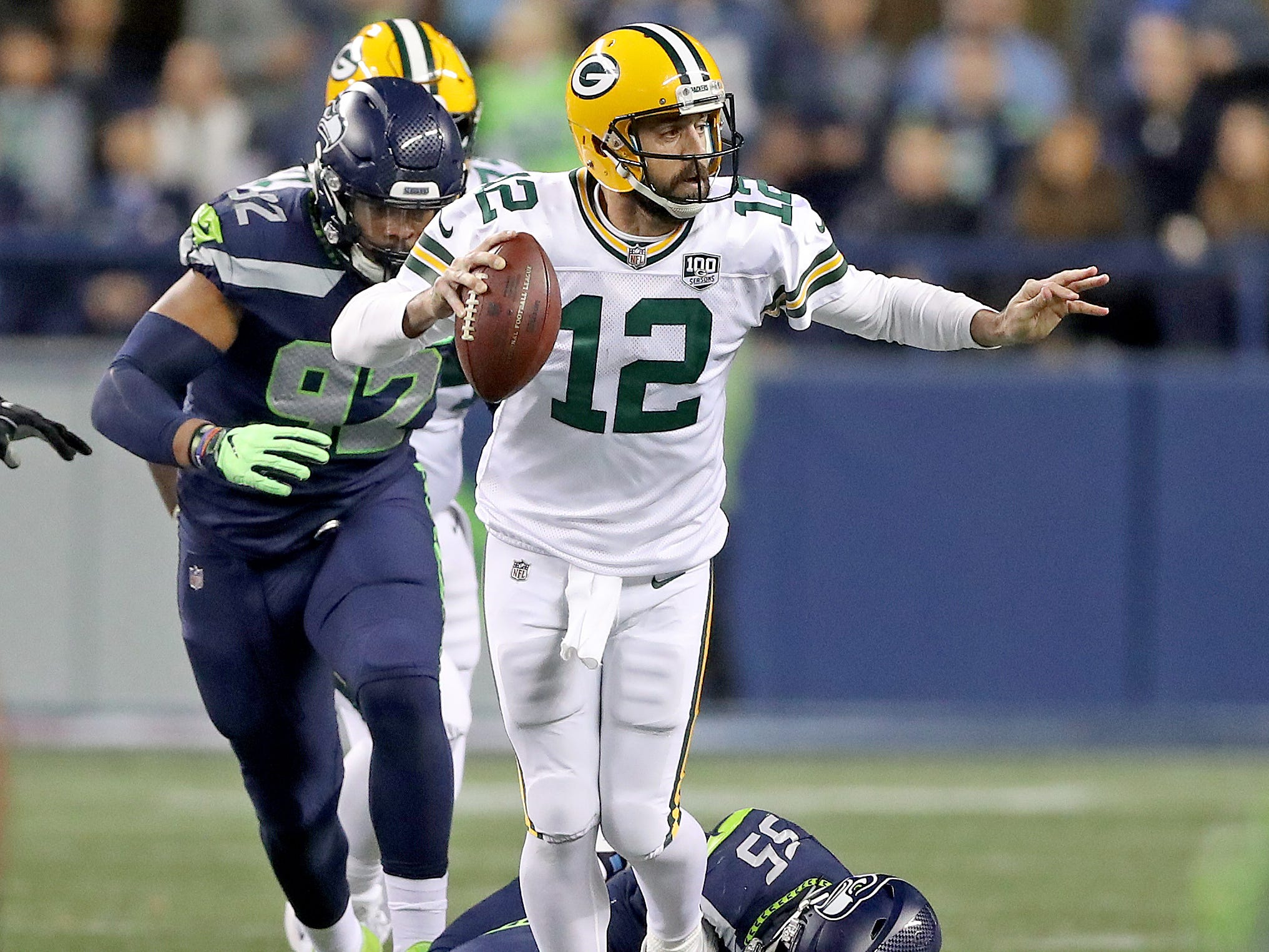 Green Bay Packers quarterback Aaron Rodgers (12) gets tripped up against the Seattle Seahawks at CenturyLink Field Thursday, November 15, 2018 in Seattle, WA. Jim Matthews/USA TODAY NETWORK-Wis