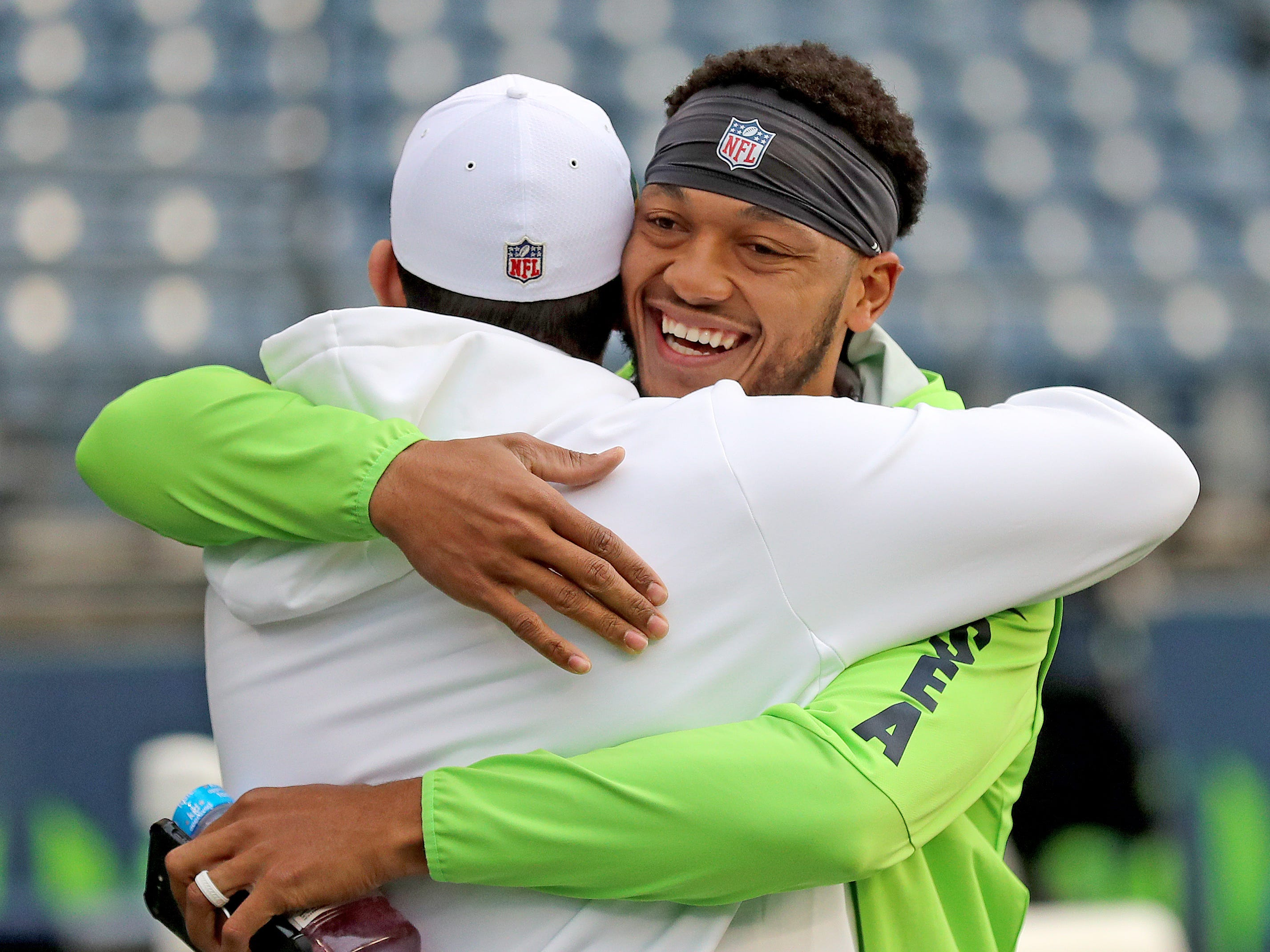 Former Packers quarterback Brett  Hundley, who was released from the Packers after training camp, hugs a Packers staff member as he greets former teammates before the game against the Seattle Seahawks at CenturyLink Field Thursday, November 15, 2018 in Seattle, WA.
