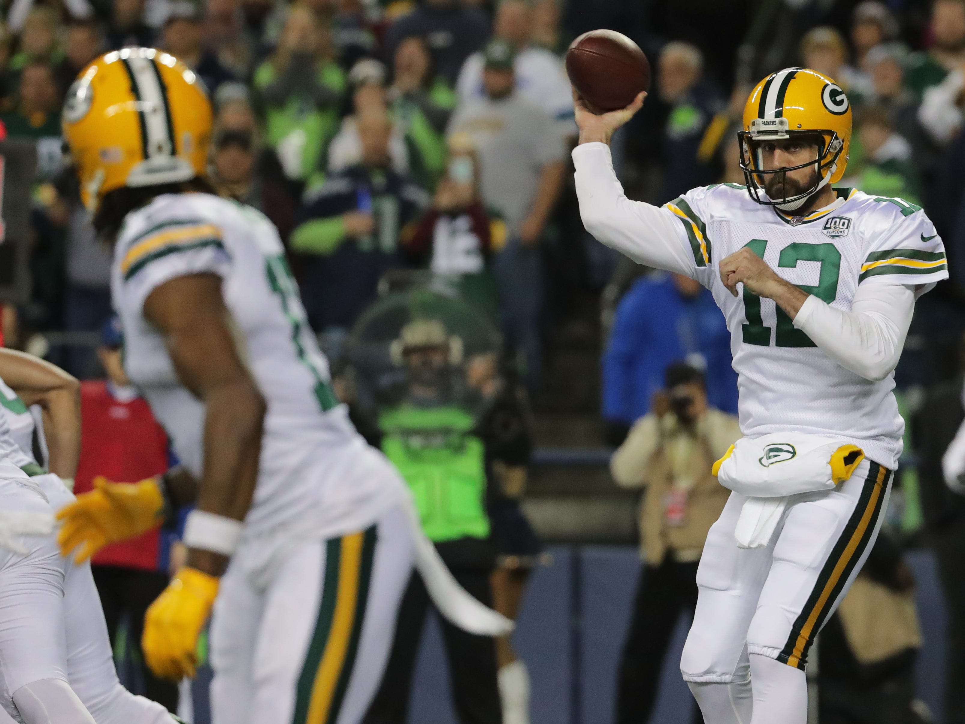 Green Bay Packers quarterback Aaron Rodgers (12) throws an 11-yard pass to wide receiver Davante Adams (17) during the second quarter of their game against the Seattle Seahawks Thursday, November 25, 2018 at CenturyLink Field in Seattle, Wash.  MARK HOFFMAN/MHOFFMAN@JOURNALSENTINEL.COM