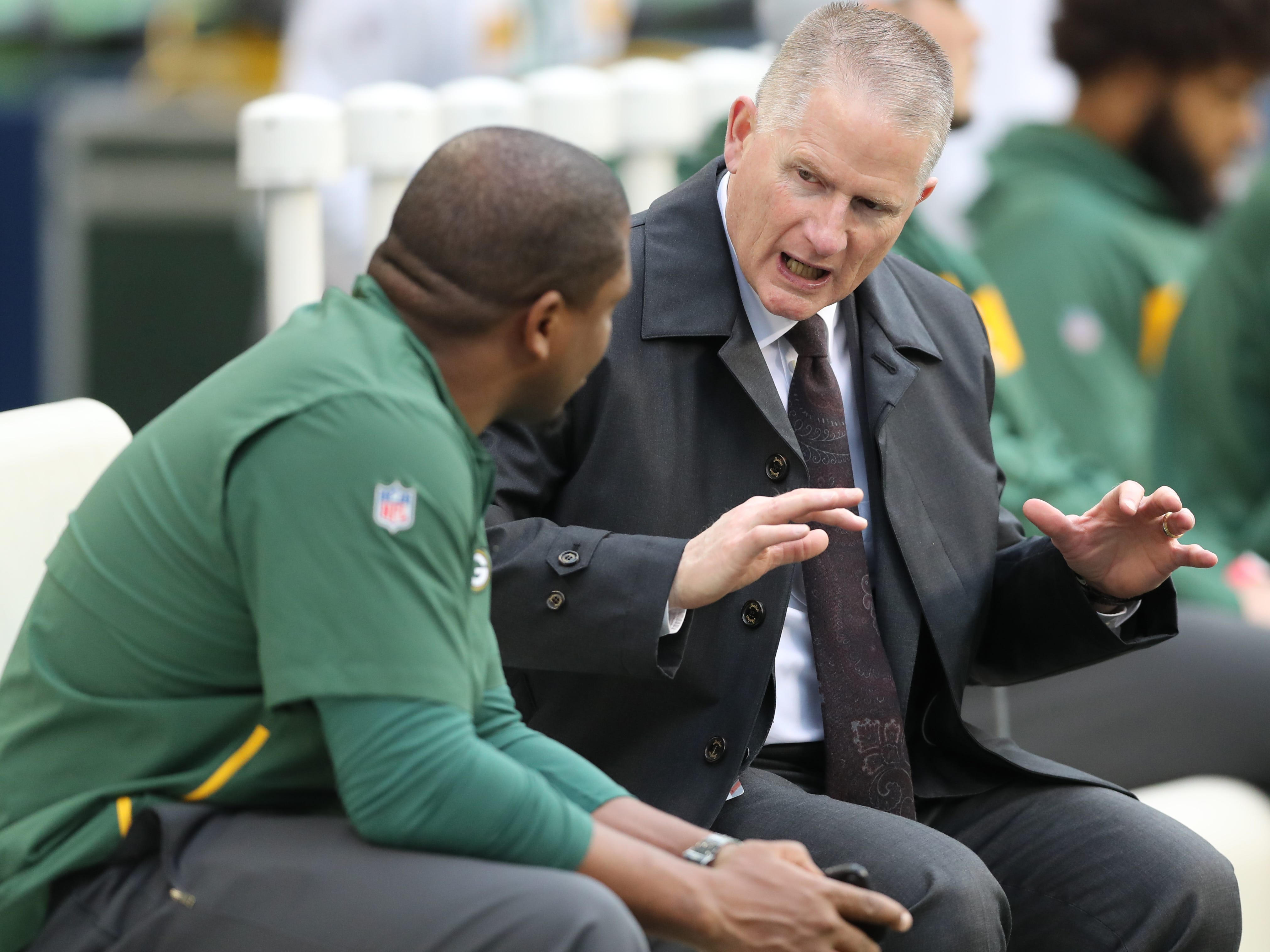 Packers Executive Vice President/Director of Football Operations Russ Ball talks with a Packers staff member on the sidelines before the game against the Seattle Seahawks at CenturyLink Field Thursday, November 15, 2018 in Seattle, WA.